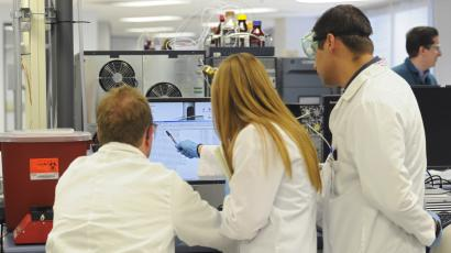Forensic scientists analyze samples in a toxicology lab