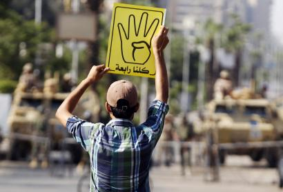 A supporter of ousted Egyptian President Mohamed Morsi protests against the military and interior ministry in Cairo.
