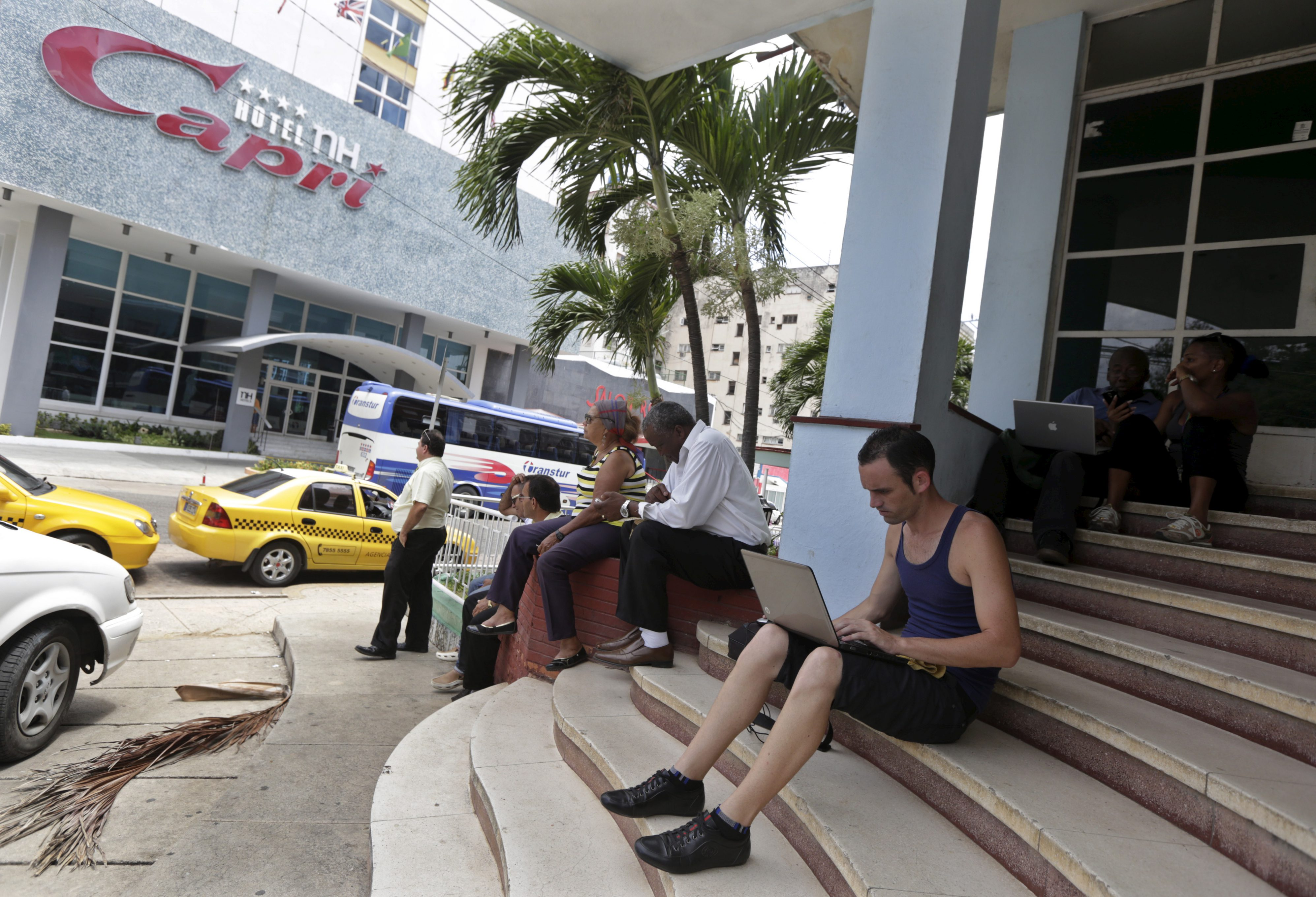 A man uses the internet via Wi-Fi in front of a hotel in Havana June 18, 2015.  Cuba remains one of the world's least connected countries, but that's slowly changing.
