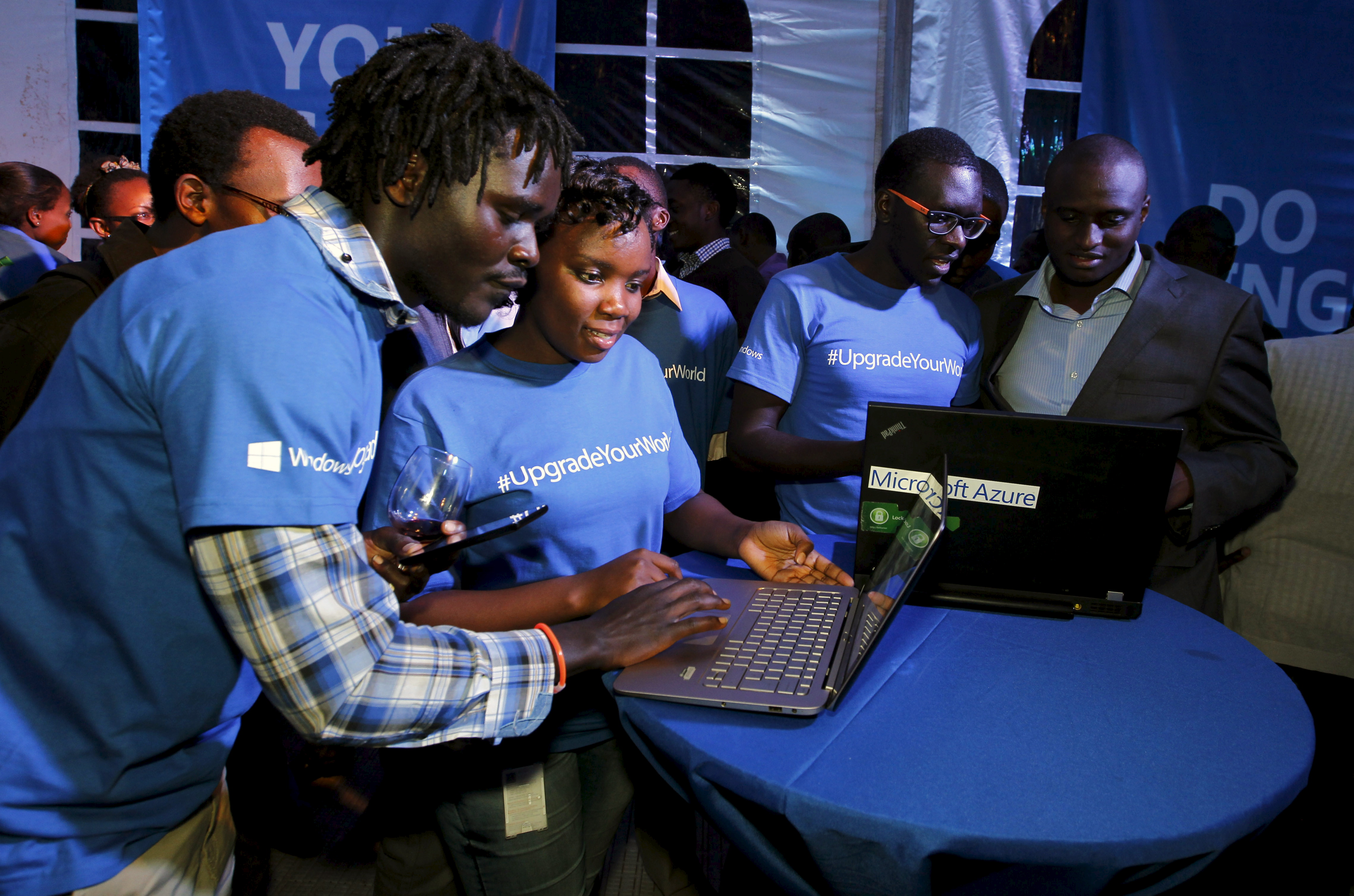 Microsoft delegates check applications in a computer during the launch of the Windows 10 operating system in Kenya's capital Nairobi