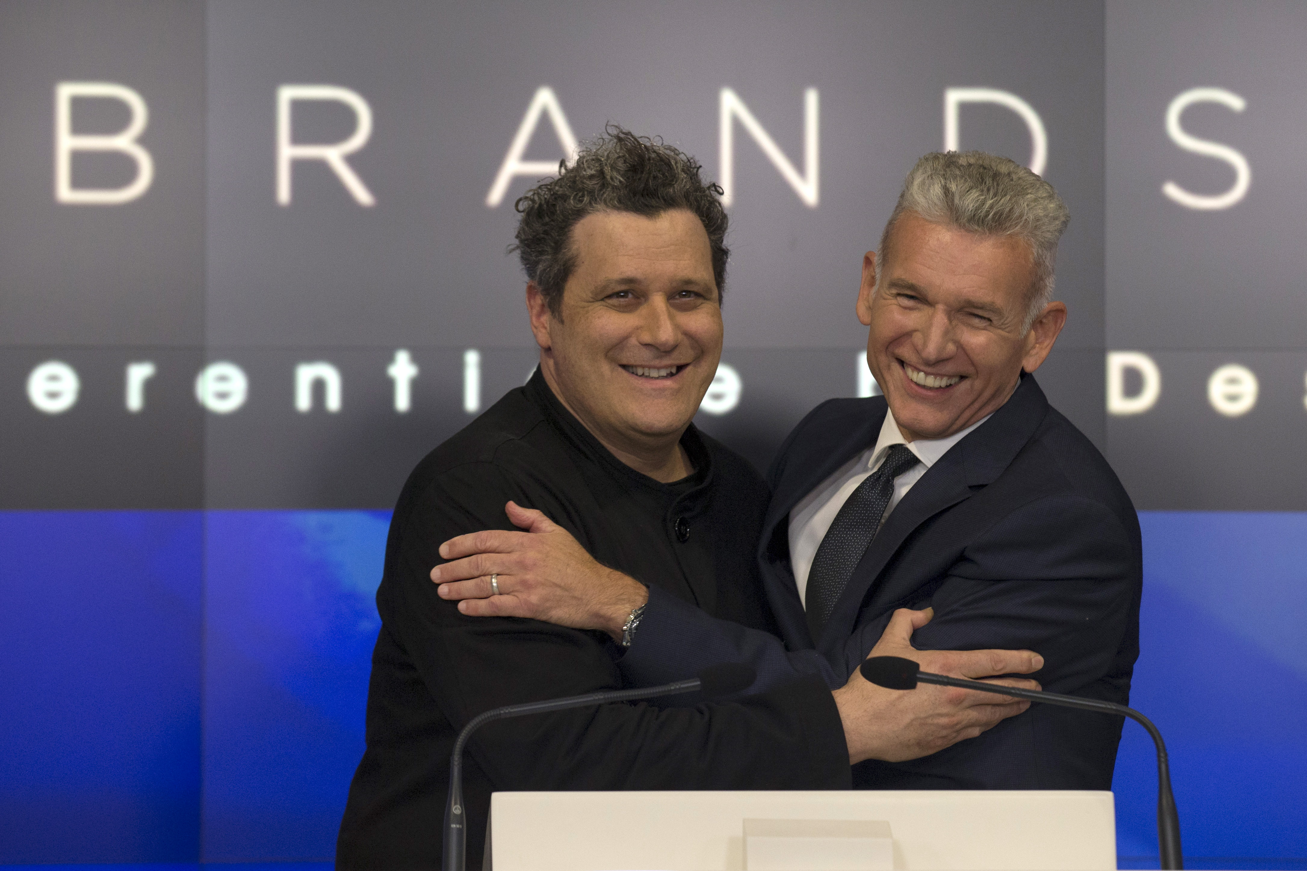 Designer Isaac Mizrahi (L) and Robert D'Loren, Chairman and Chief Executive Officer of Xcel Brands, Inc. pose together before ringing the closing bell at the Nasdaq Market site in New York September 2, 2015. REUTERS/Brendan McDermid - RTX1QT76