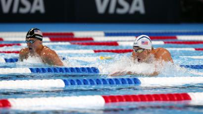 Jul 1, 2016; Omaha, NE, USA; Michael Phelps (right) and Ryan Lochte swim during the mens 200 meter individual medley final in the U.S. Olympic swimming team trials at CenturyLink Center. Mandatory Credit: Erich Schlegel-USA TODAY Sports
