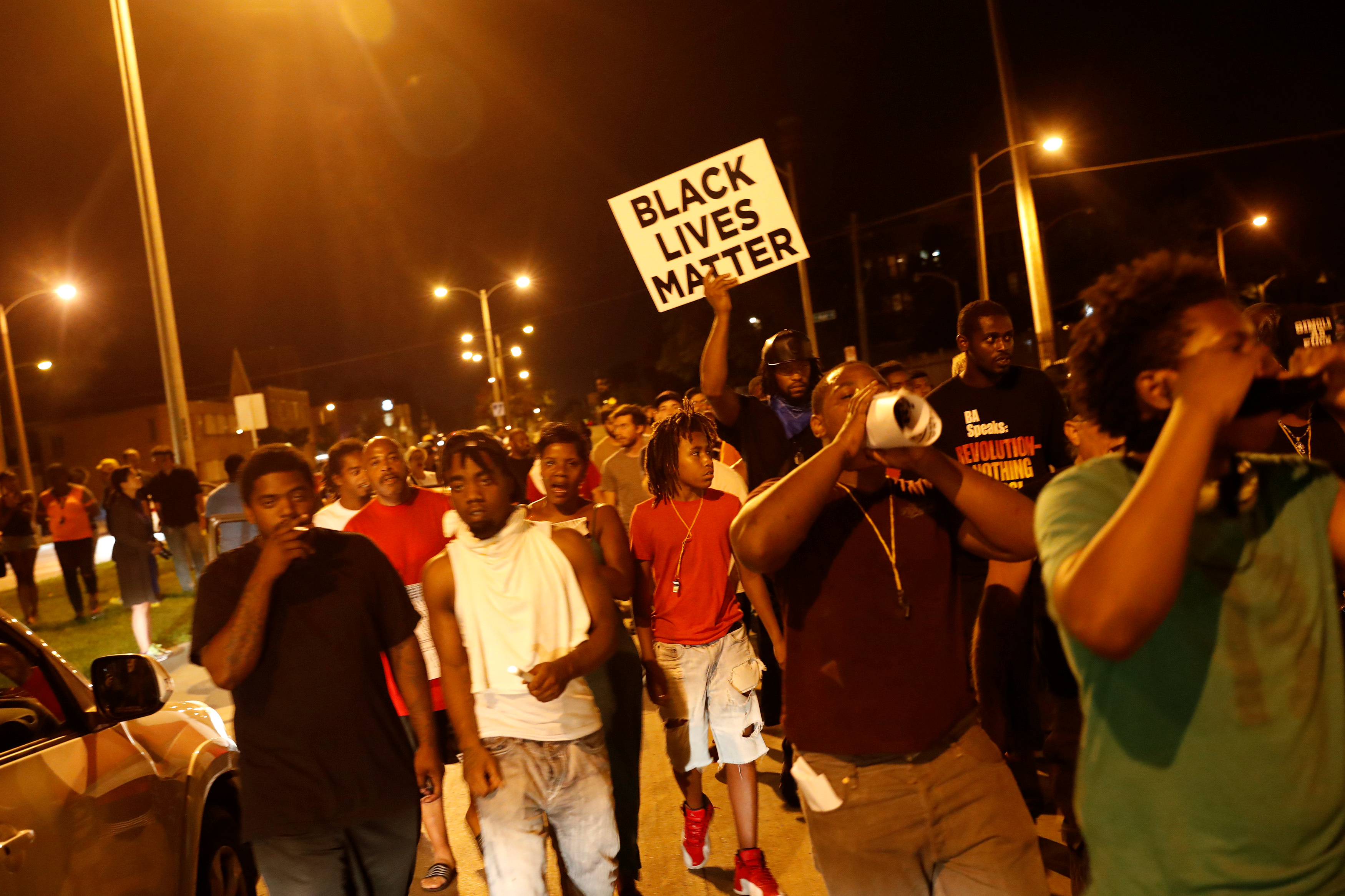 Protestors march during disturbances following the police shooting of a man in Milwaukee, Wisconsin