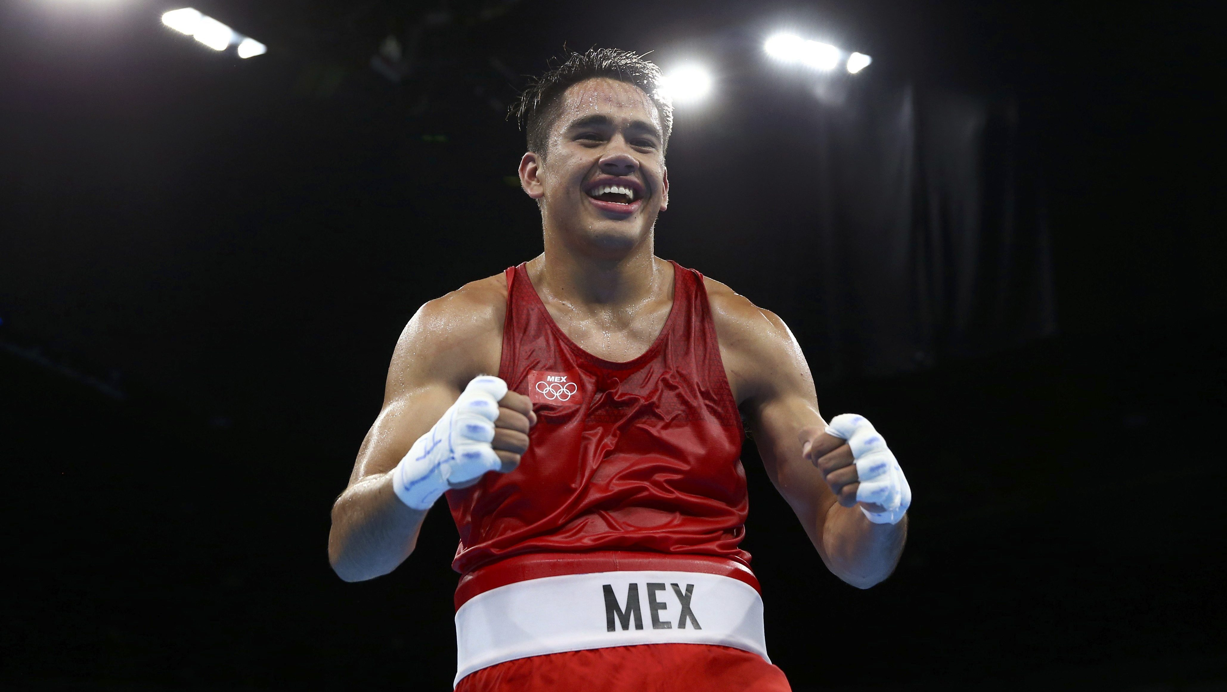 Misael Rodriguez of Mexico celebrates after winning his bout.