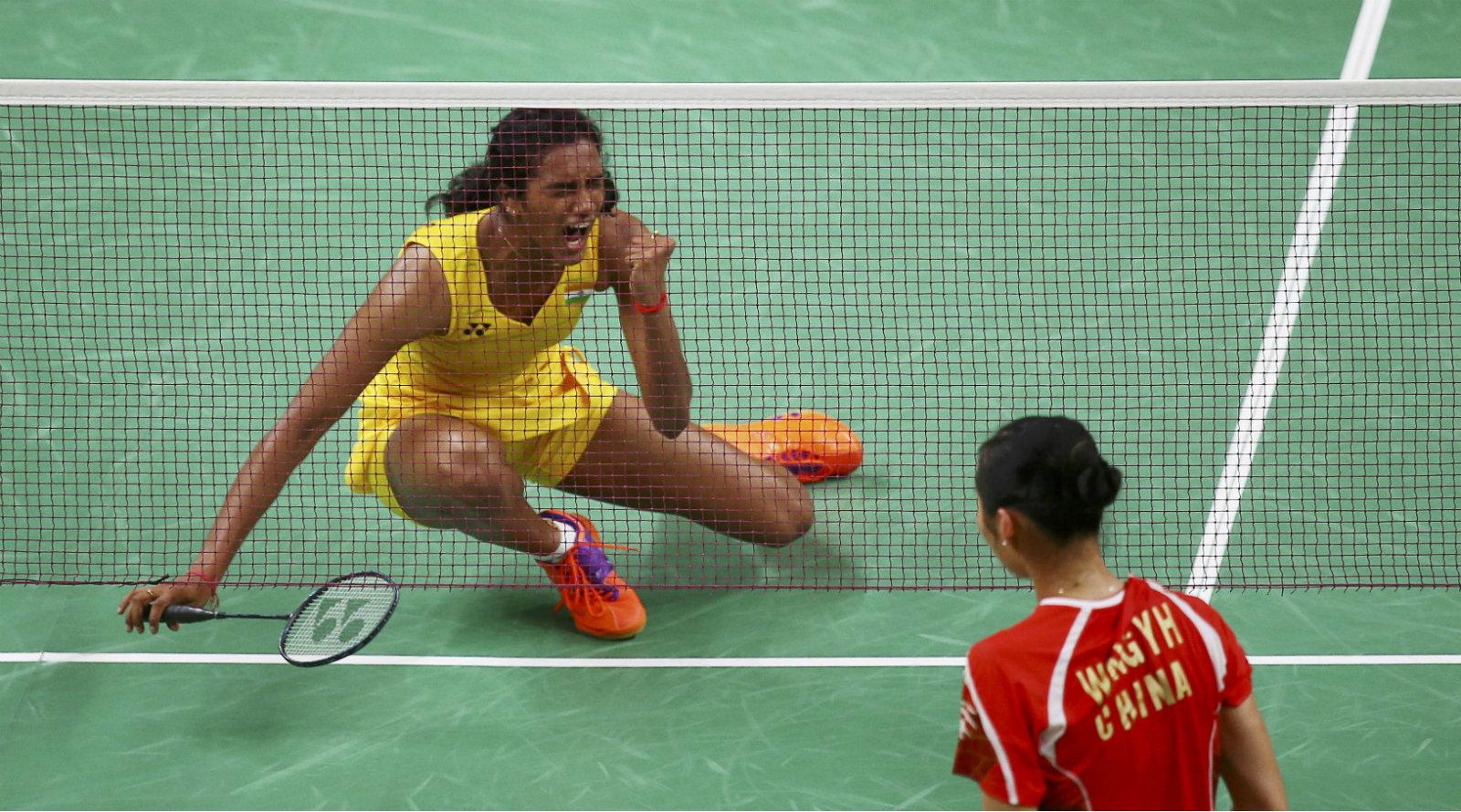 India's P.V. Sindhu celebrates after winning her match against Wang Yihan of China.
