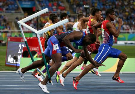 Haiti's Jeffrey Julmis crashes and falls as he competes in the men's 110-meter hurdles semi-final at the Rio 2016 Olympics.