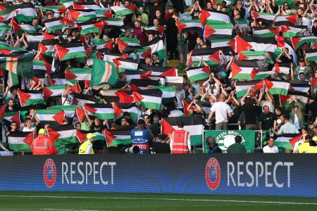 Celtic fans hold up Palestine flags Action Images via Reuters / Russell Cheyne Livepic EDITORIAL USE ONLY. - RTX2LL97