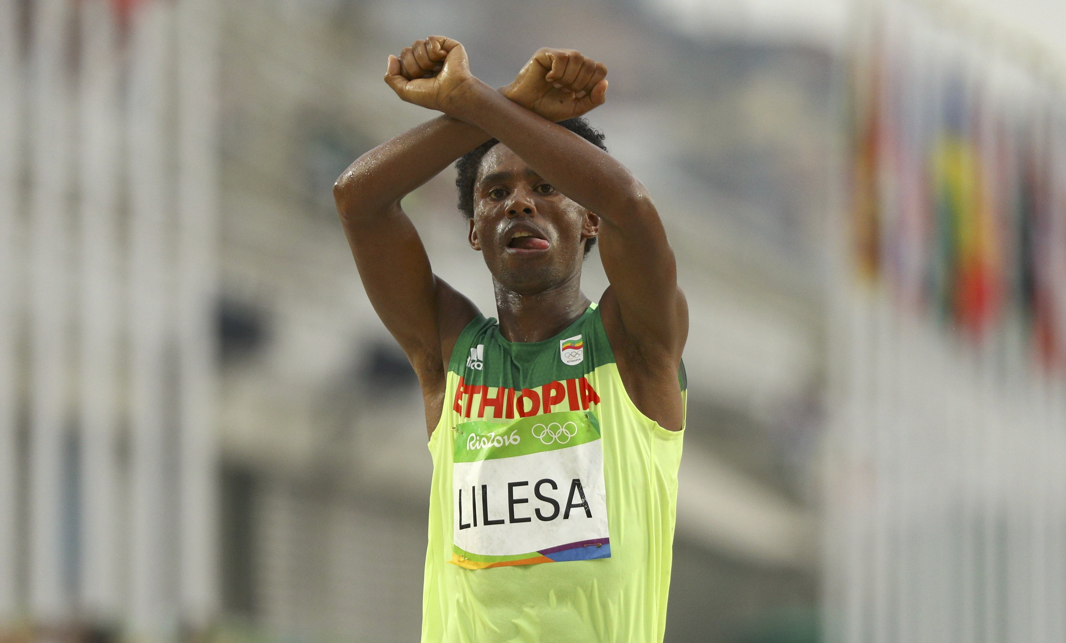 Ethiopia's Feyisa Lilesa standing with the Oromo protests.