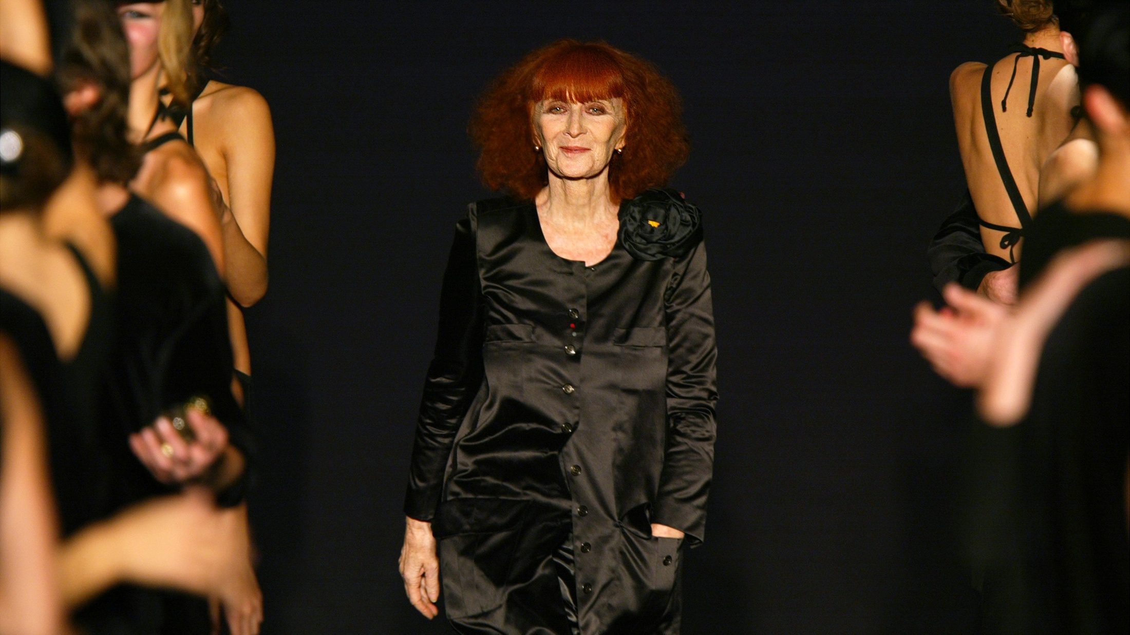Models applaud French designer Sonia Rykiel at the end of her Spring-Summer ready-to-wear women's fashion collection for 2004 in Paris, France, October 9, 2003. Sonia Rykiel, known for her brightly coloured striped outfits, has died at the age of 86, the parent company of the fashion label she founded said August 25, 2016. REUTERS/Charles Platiau/File Photo