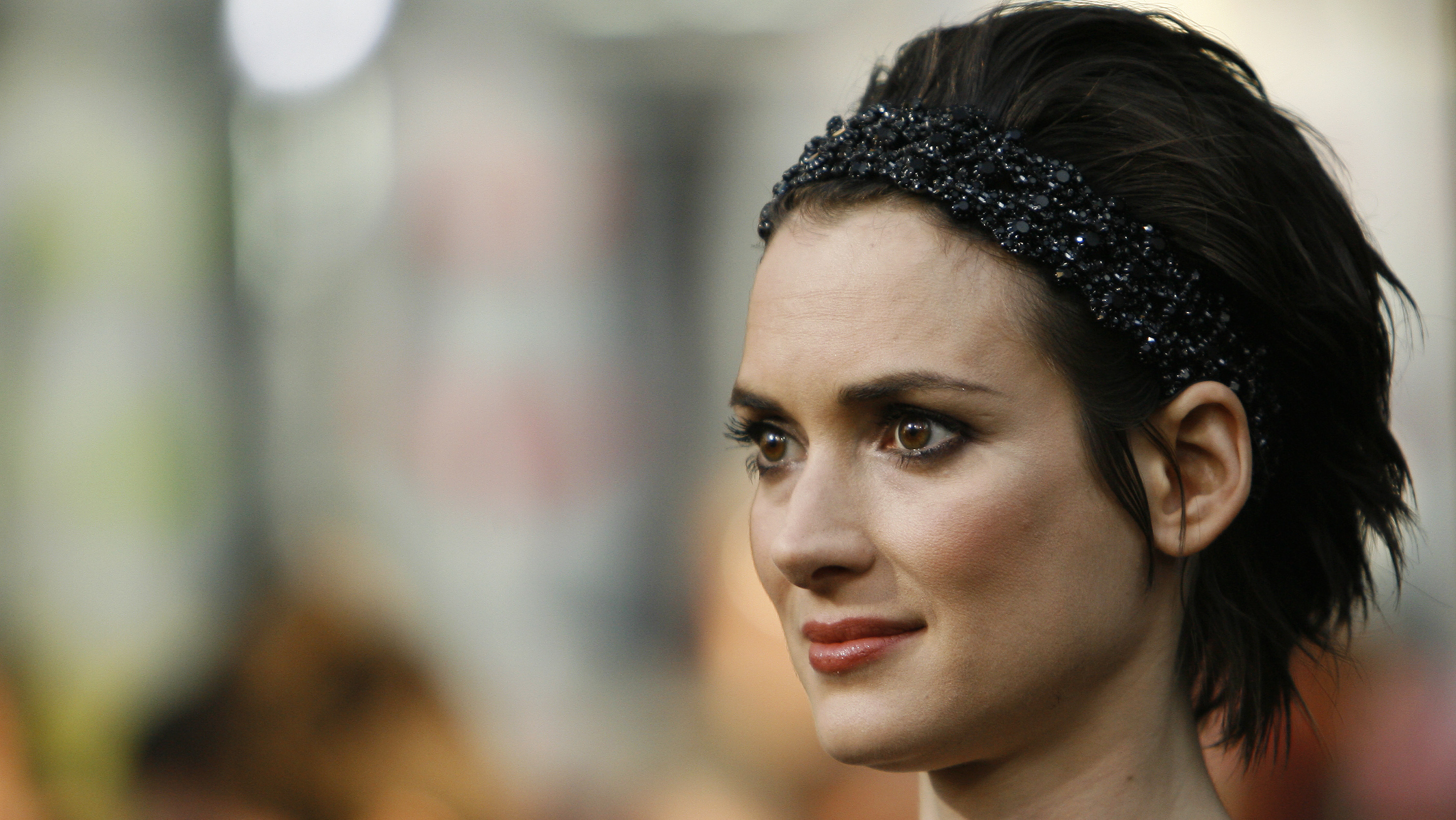 Winona Ryder poses at the premiere of the movie Star Trek at the Grauman's Chinese theatre in Hollywood