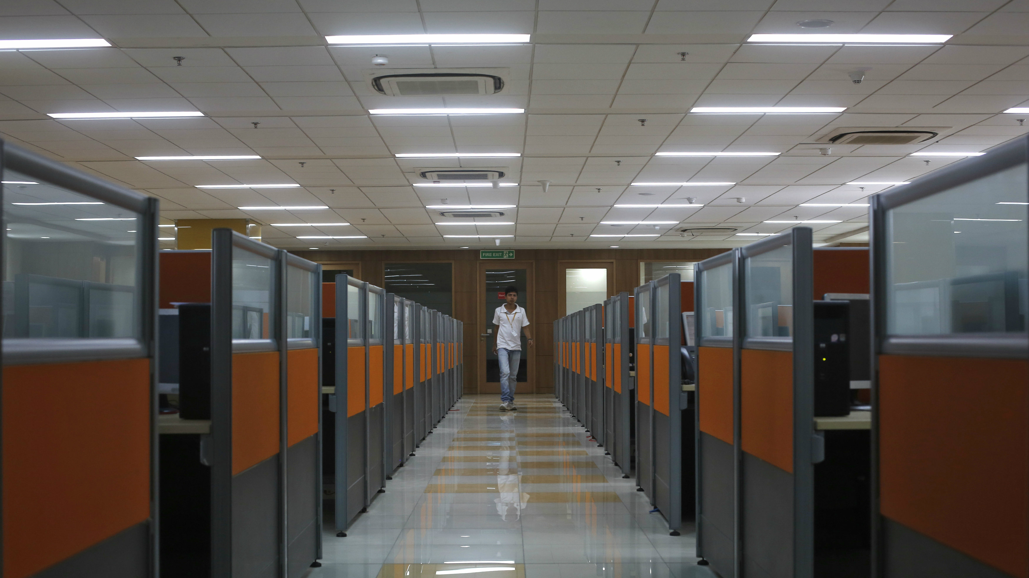 An employee arrives at Tech Mahindra office building in Noida on the outskirts of New Delhi March 18, 2013