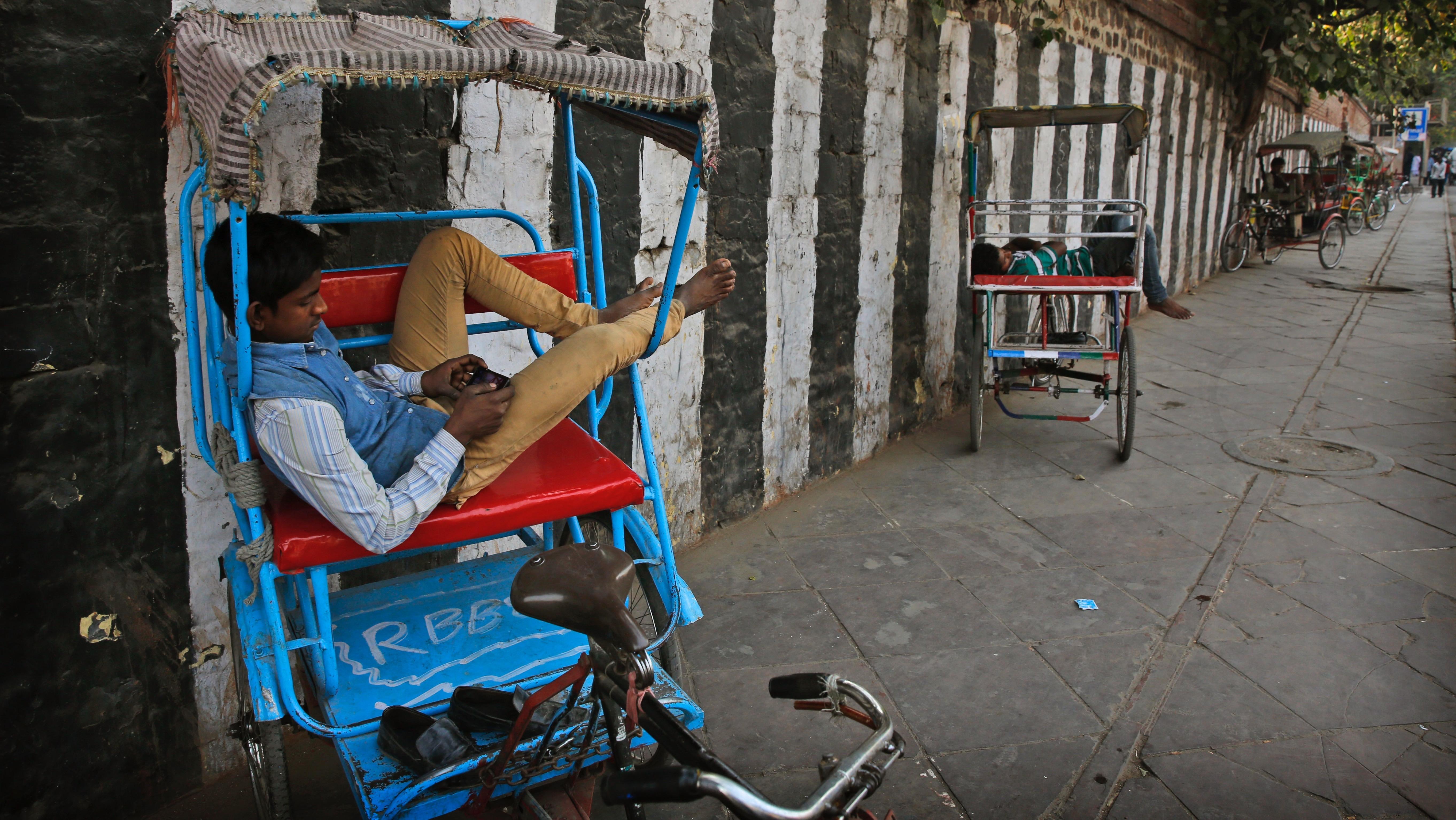 Indian man on phone playing game