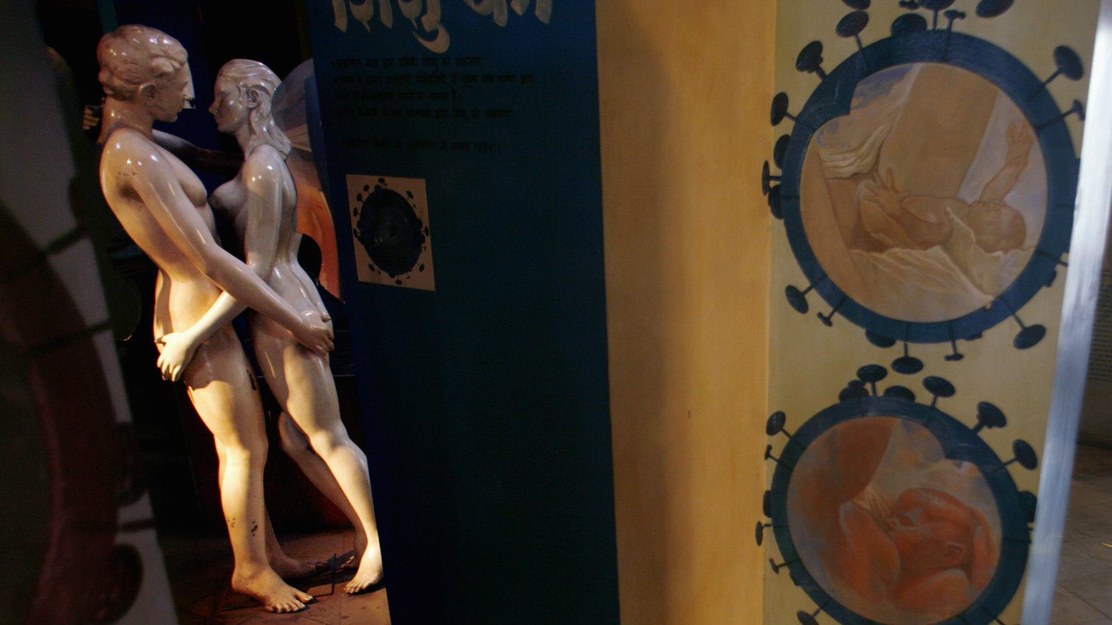 A man walks past an exhibit in the Sexual Health Information Art Gallery in Mumbai January 29, 2007.