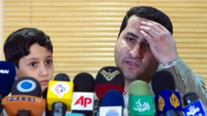 Shahram Amiri speaking next to his son after his July 2010 return to Iran.