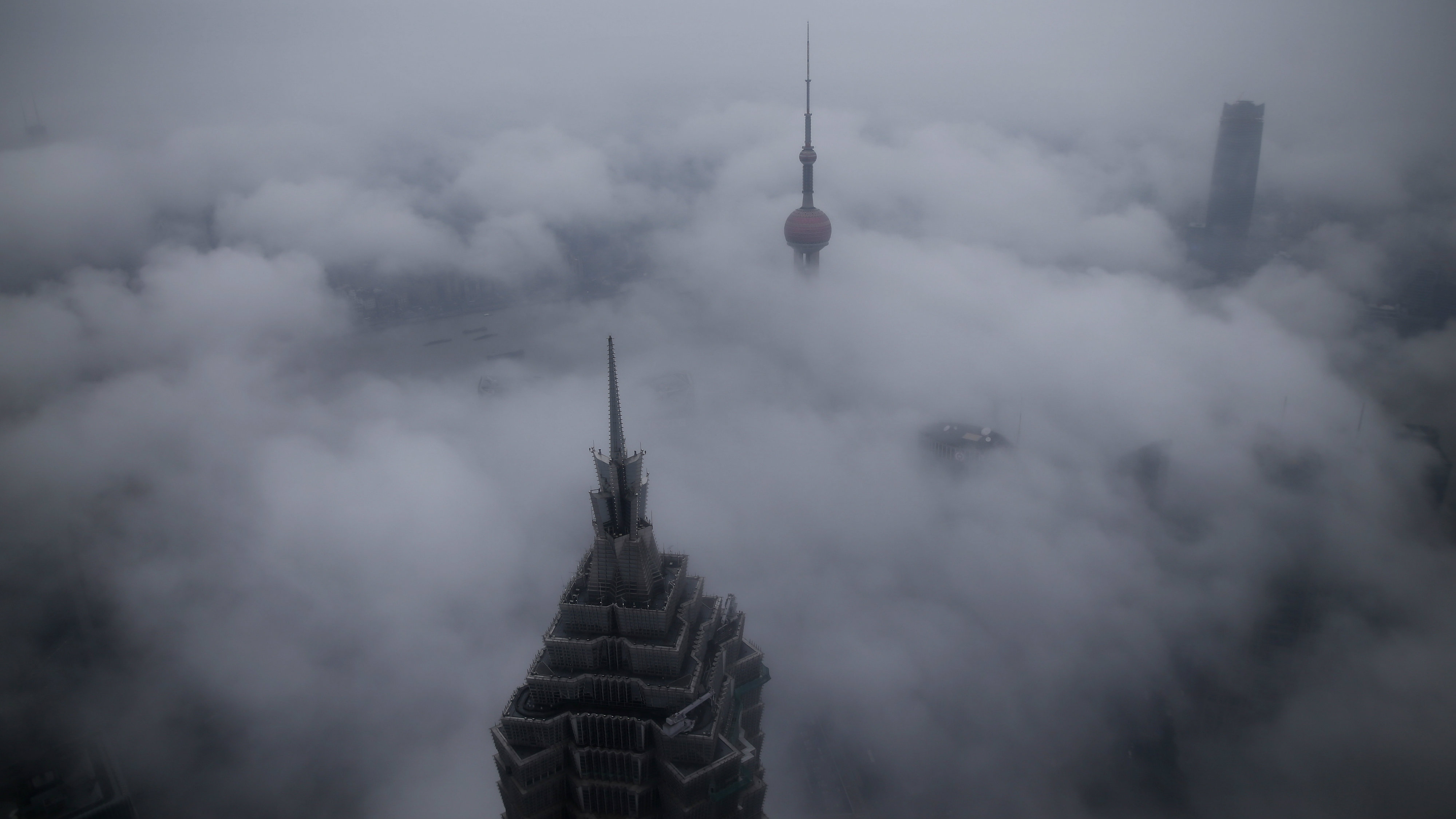 Skyscrapers Oriental Pearl Tower and Jin Mao Tower (L) are seen from the Shanghai World Financial Center, in rain at the financial district of Pudong in Shanghai, China, January 28, 2016.