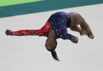 Simone Biles performs on the floor during the Women's Qualification of the Rio 2016.