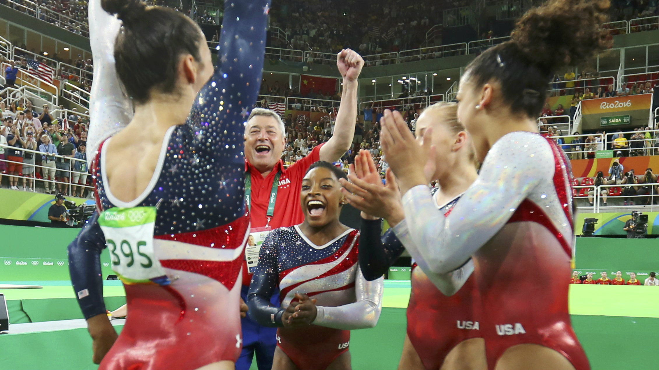 Simone Biles and the Team USA artistic gymnastics team celebrate at the 2016 Olympic Games in Rio.