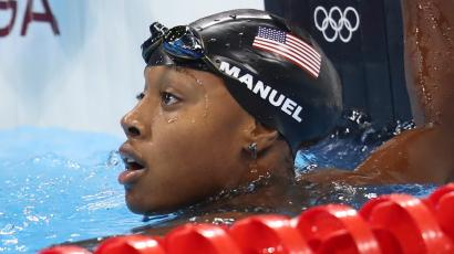 Simone Manuel becomes the first African-American female swimmer to win gold at the Olympics.