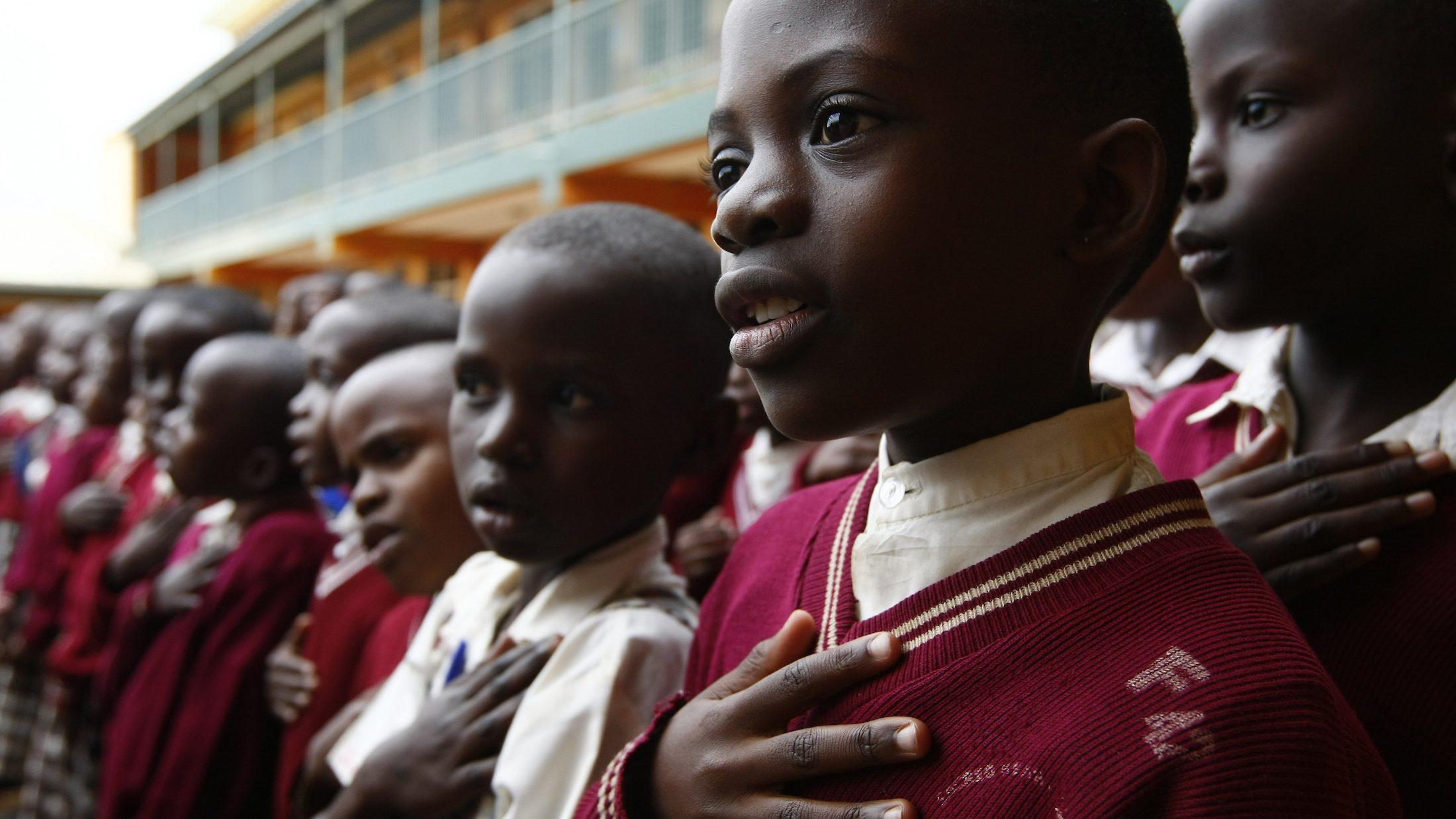 Students sing during morning assembly at Kyamusansala Primary School in Masaka