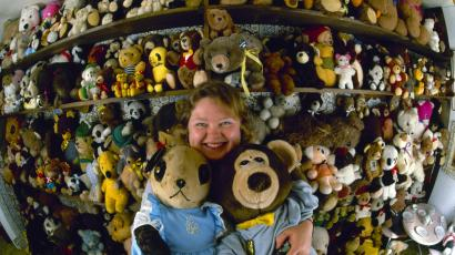 Lilly Andrews hugs a pair of her 3,000 teddy bears in her Pittsburgh, Pa., home, 1986. Andrews and her husband, Milt, have been accumulating the furry toys from flea markets, shops and garbage cans for the past four years.
