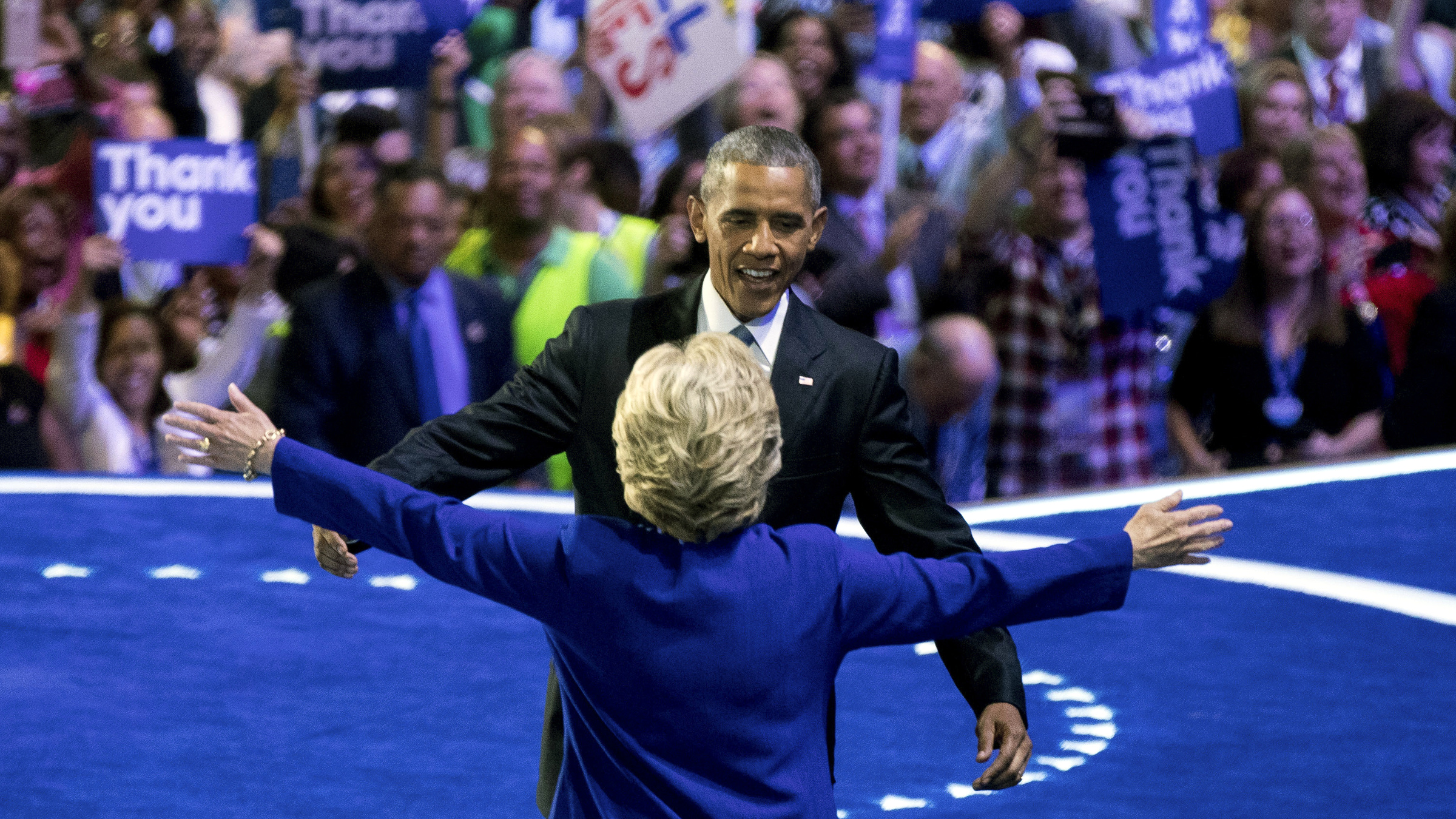 President Barack Obama and Democratic presidential candidate Hillary Clinton embrace as they appear on stage together on the third day session of the Democratic National Convention in Philadelphia , Wednesday, July 27, 2016.