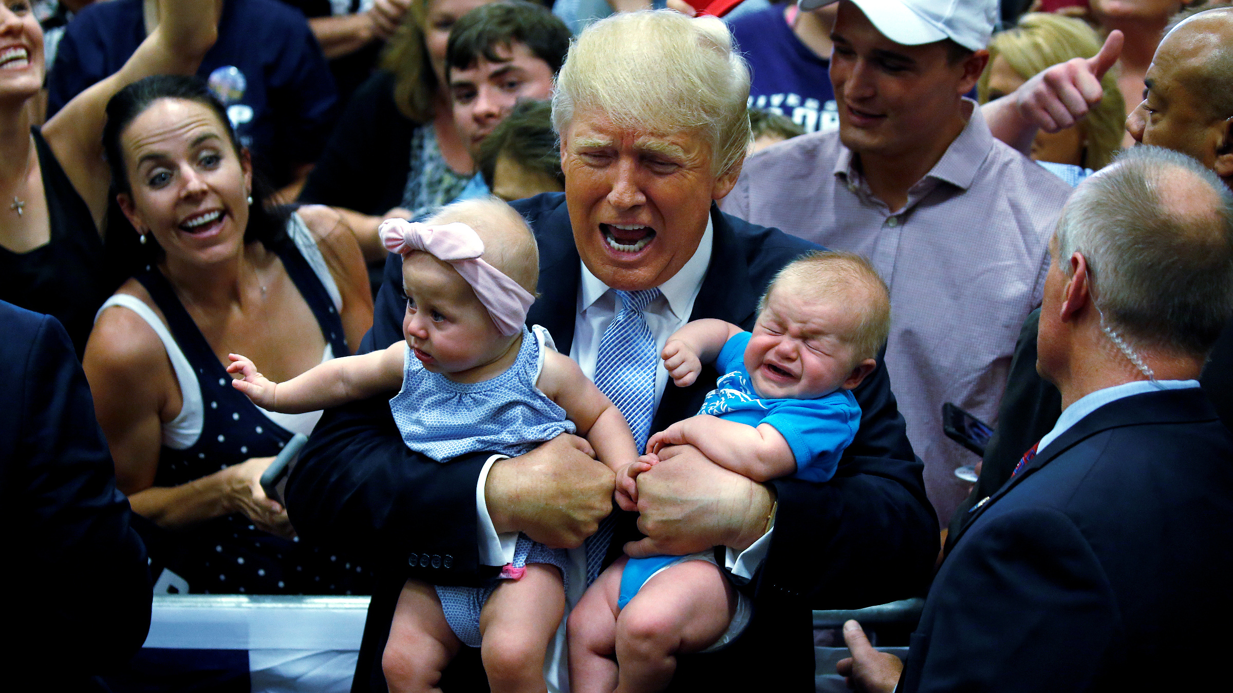 QUALITY REPEAT - Republican presidential nominee Donald Trump holds babies at a campaign rally in Colorado Springs, Colorado, U.S., July 29, 2016.