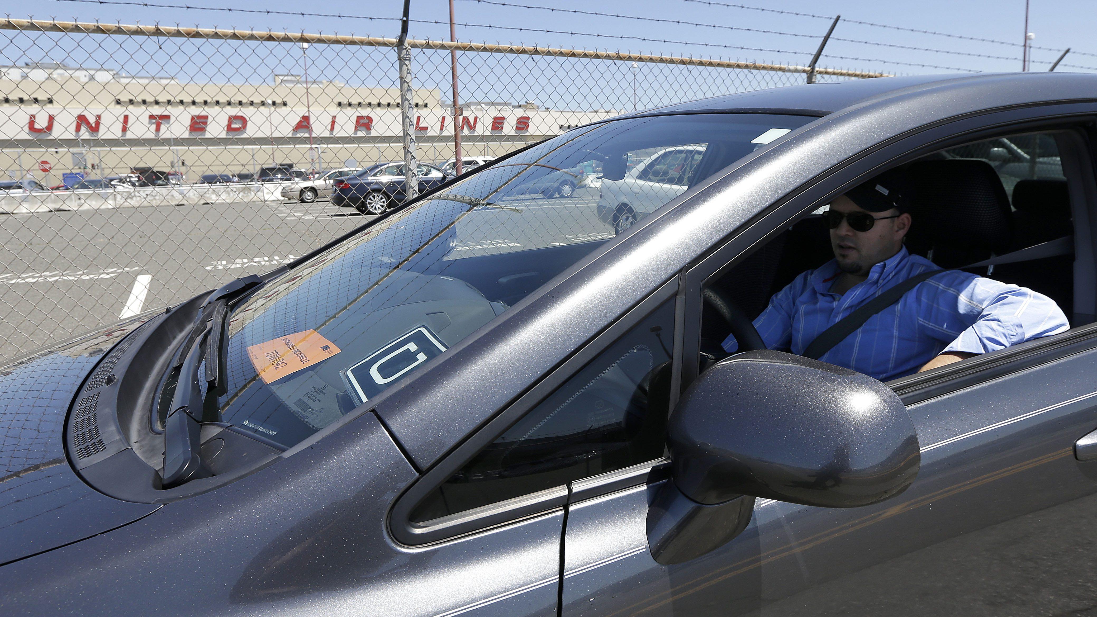 An Uber driver waits for a passenger.