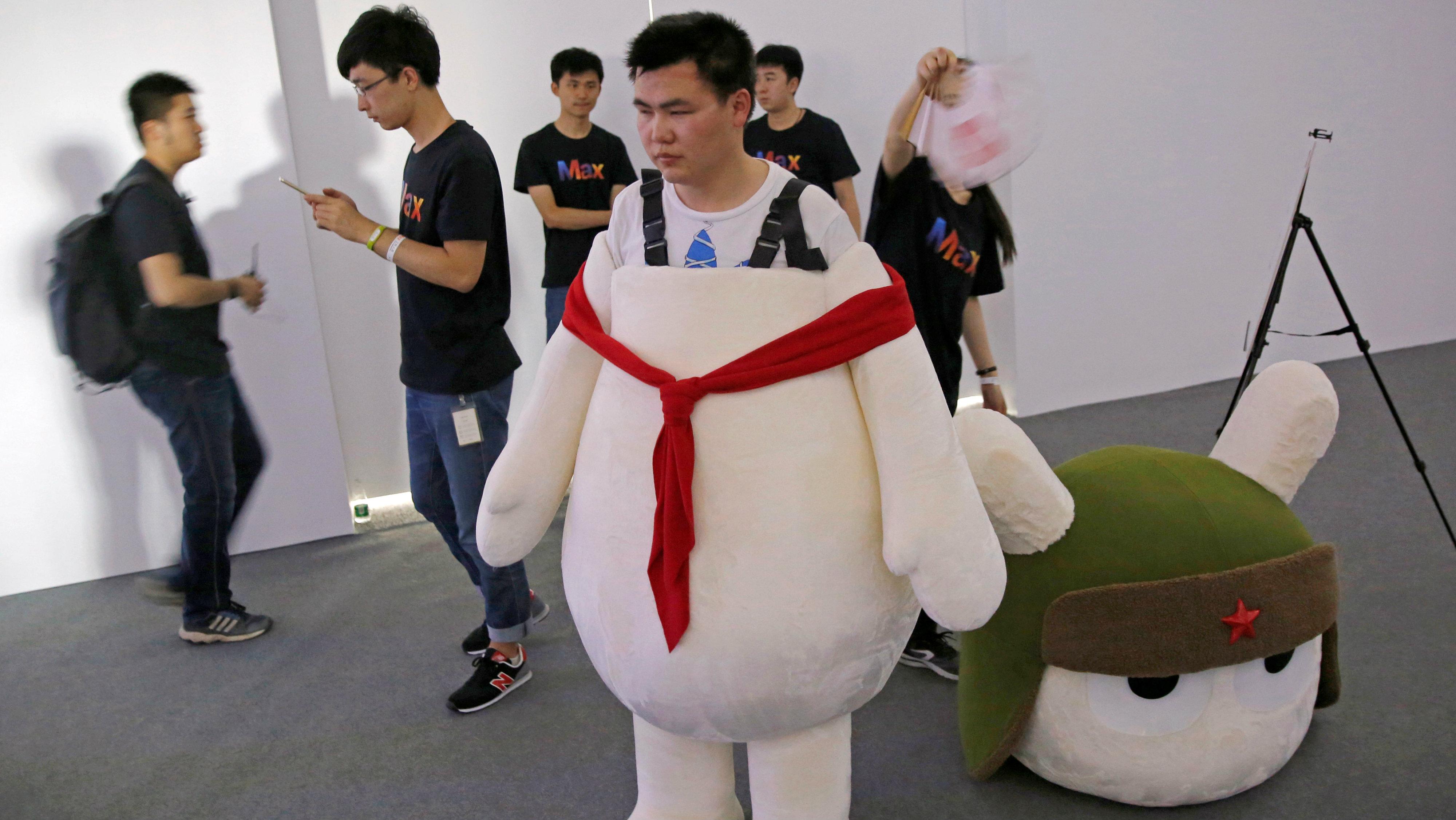 A worker wears a Xiaomi marketing suit.