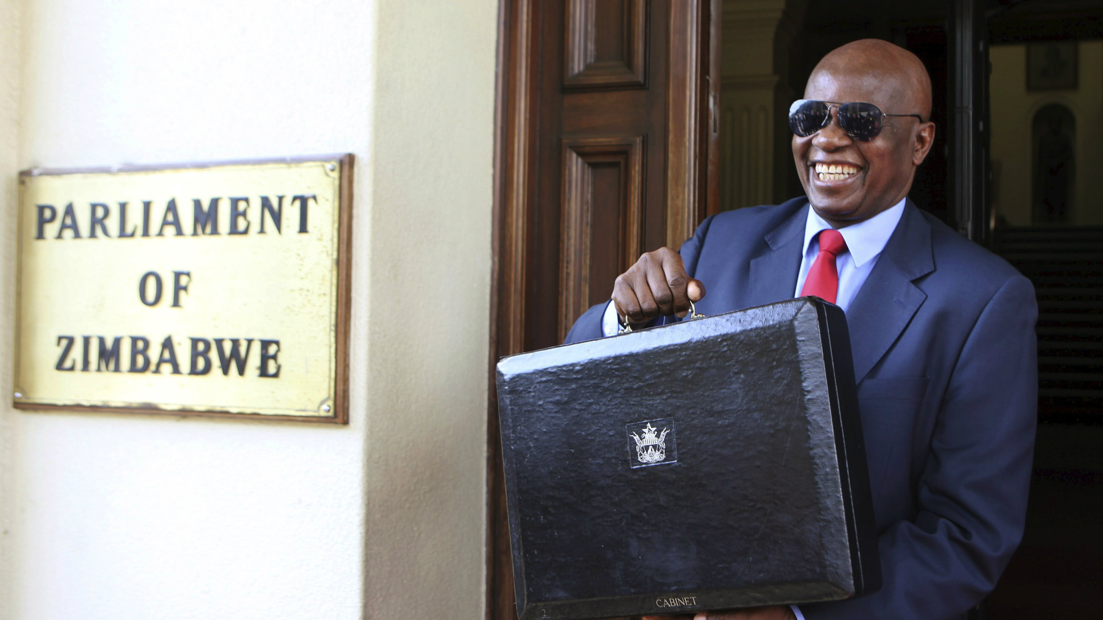 Zimbabwe's finance minister Patrick Chinamasa outside of the parliament building in Harare