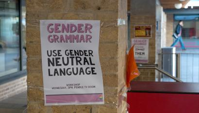 A sign promotes the use of gender neutral language.