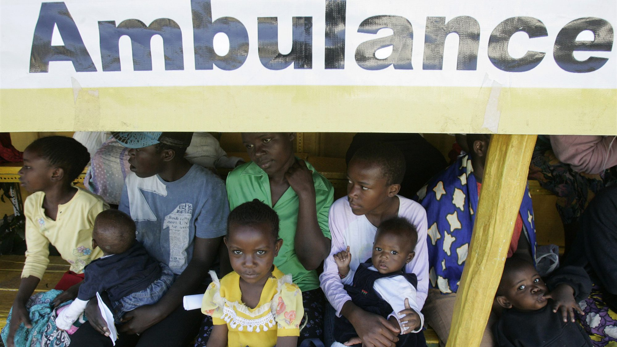 Displaced people wait in a line to be seen by a doctor at a centre run by St. Johns Ambulance at the Nairobi Show Grounds