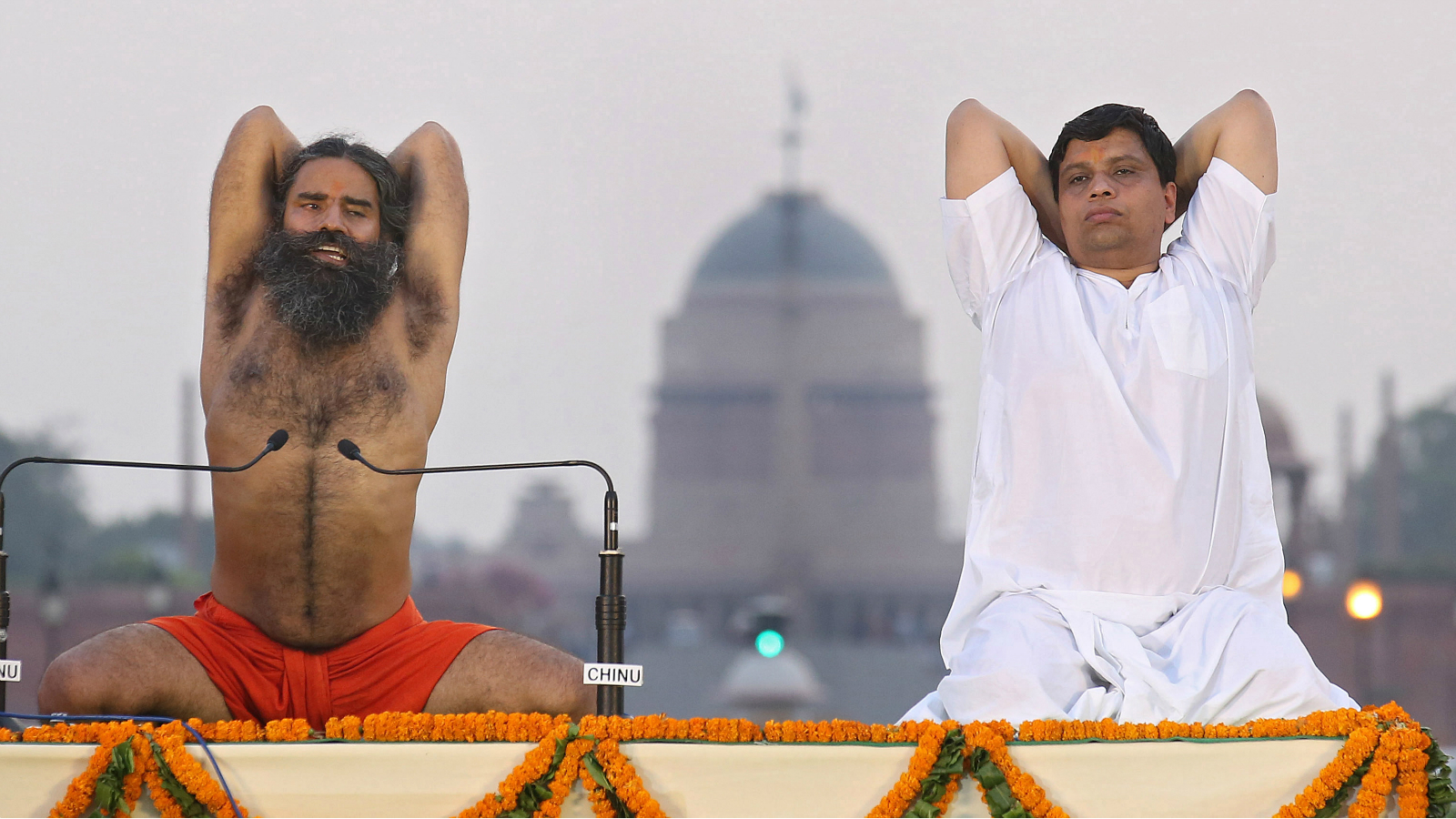 Indian Yoga Guru Baba Ramdev (L) leads yoga exercises with his associate Balkrishna (R) during the rehearsals of the second International Day of Yoga, at Rajpath in New Delhi, India, 19 June 2016. International Yoga Day will be observed on 21 June 2016.