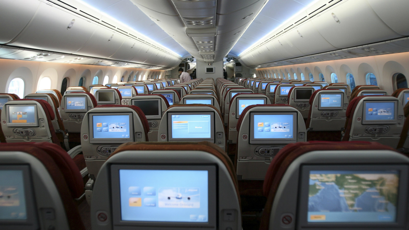 A media personnel stands in the aisle of the newly inducted Boeing 787-8 series Dreamliner aircraft during a photo call at the five-day-long India Aviation 2012 event in the southern Indian city of Hyderabad March 15, 2012.