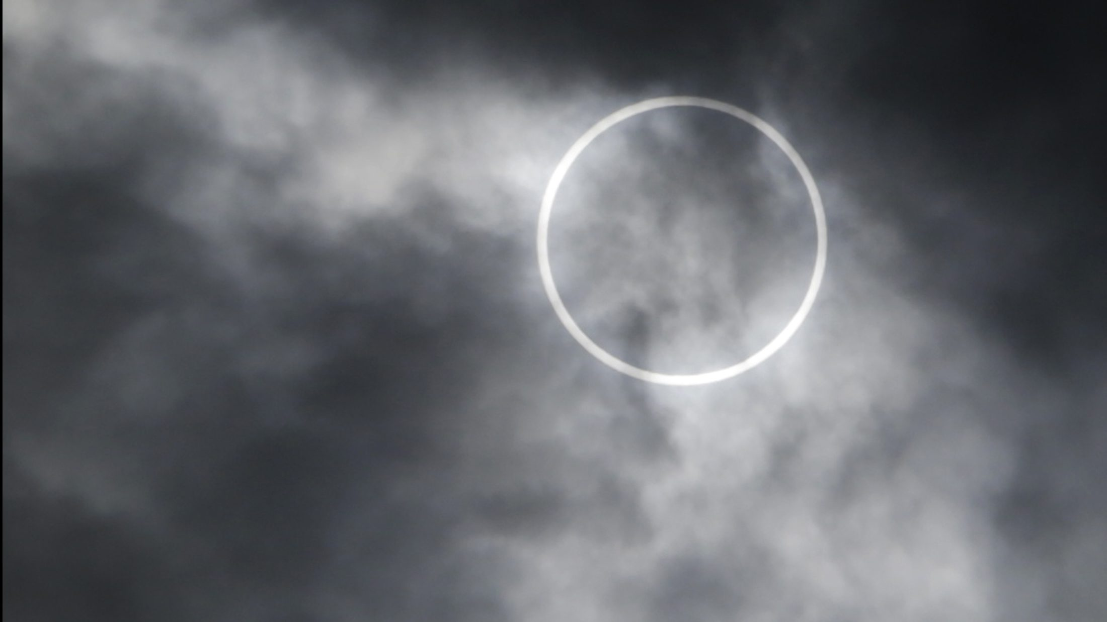 An annular solar eclipse is seen from a rooftop of the Roppongi Hills complex in Tokyo