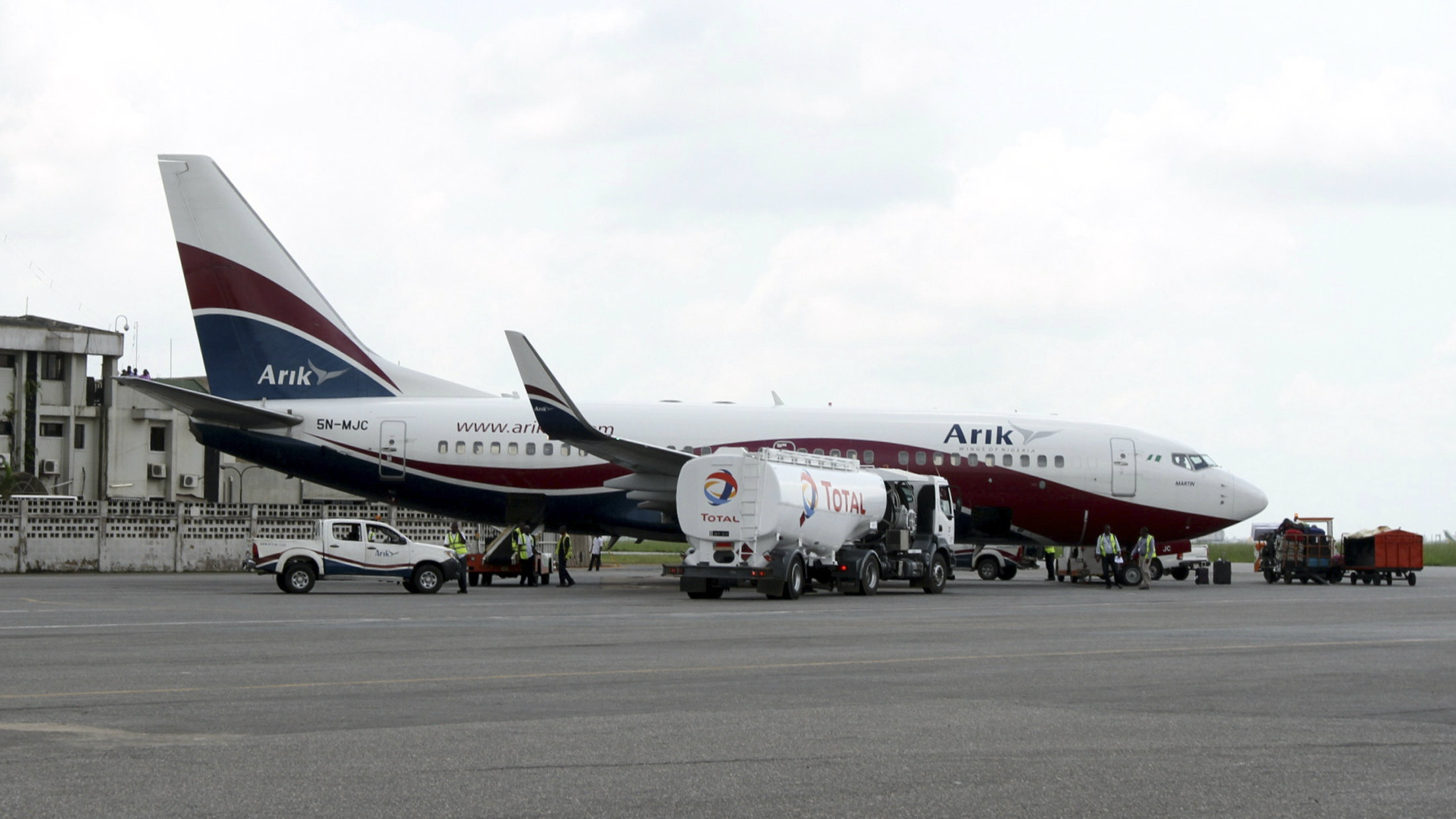 A Boeing 737-7BD Arik Air aeroplane is seen parked on the tarmac at the local airport in Lagos November 2, 2012.
