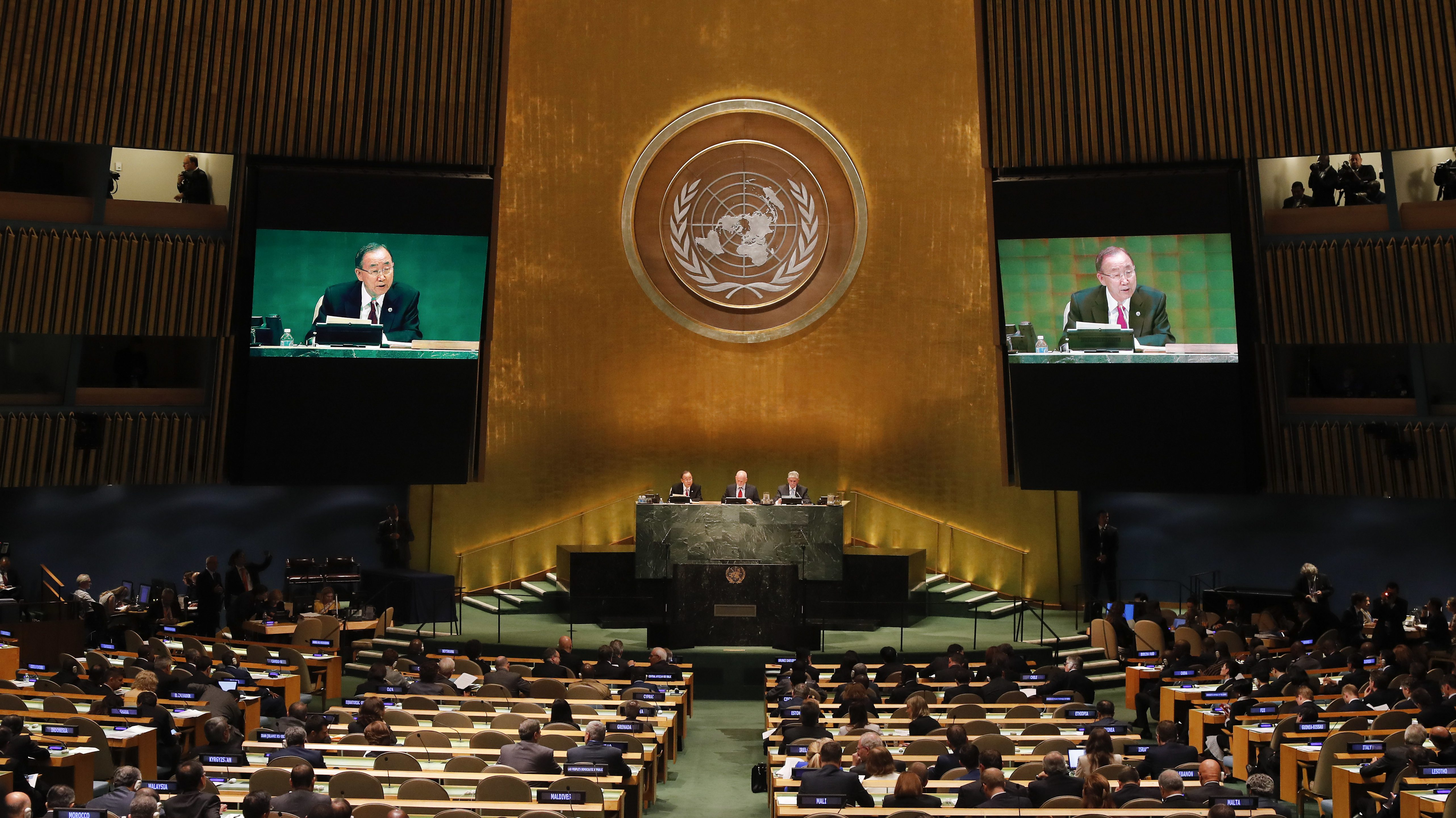 United Nations Secretary-General Ban Ki-moon speaks as President of the 71st session of the General Assembly Peter Thomson, center, and Mogens Lykketoft, President of the 70th session of the General Assembly look on during the opening of a summit addressing large movements of refugees and migrants, Monday, Sept. 19, 2016, at U.N. headquarters. (AP Photo/Julie Jacobson)