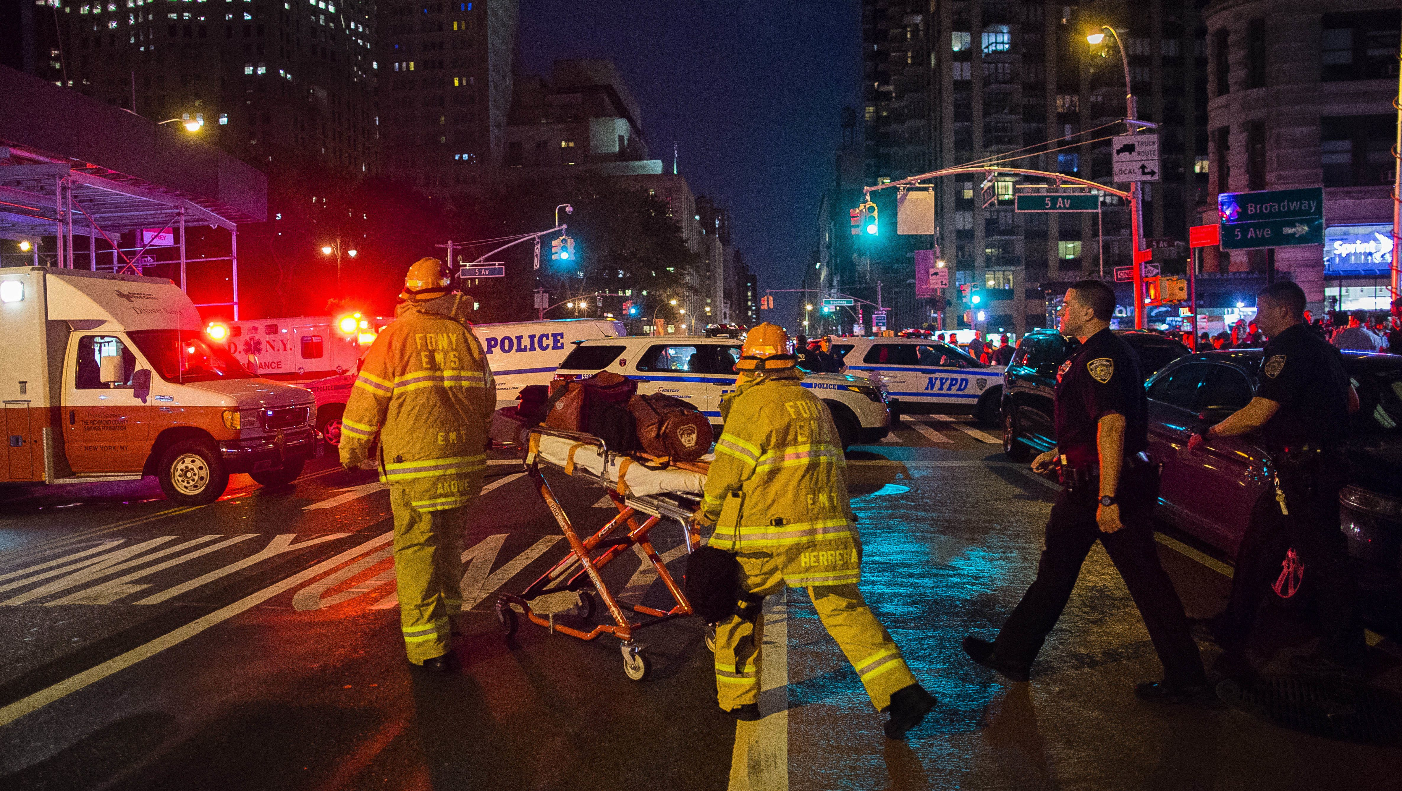 In this Sept. 17, 2016 file photo, first responders work near the scene of an explosion in Manhattan's Chelsea neighborhood, in New York. Although the pressure cooker bomb that wounded over two dozen people on the street went off in front of an apartment building for the blind, none of the building's residents were hurt in the blast. (AP Photo/Andres Kudacki, File)