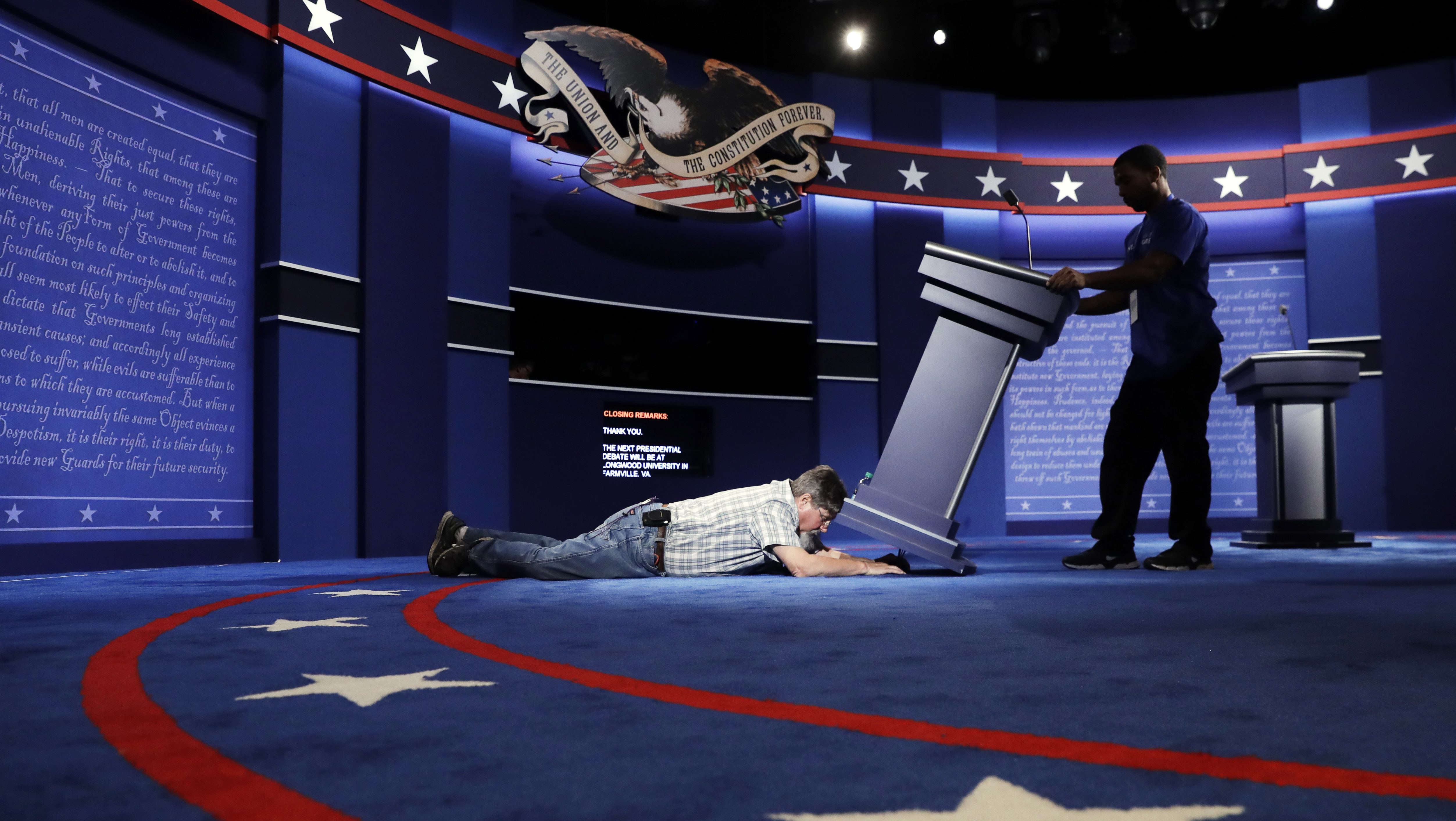 Technicians set up the stage for the presidential debate between Democratic presidential candidate Hillary Clinton and Republican presidential candidate Donald Trump at Hofstra University in Hempstead, N.Y., Sunday, Sept. 25, 2016. (AP Photo/Patrick Semansky)