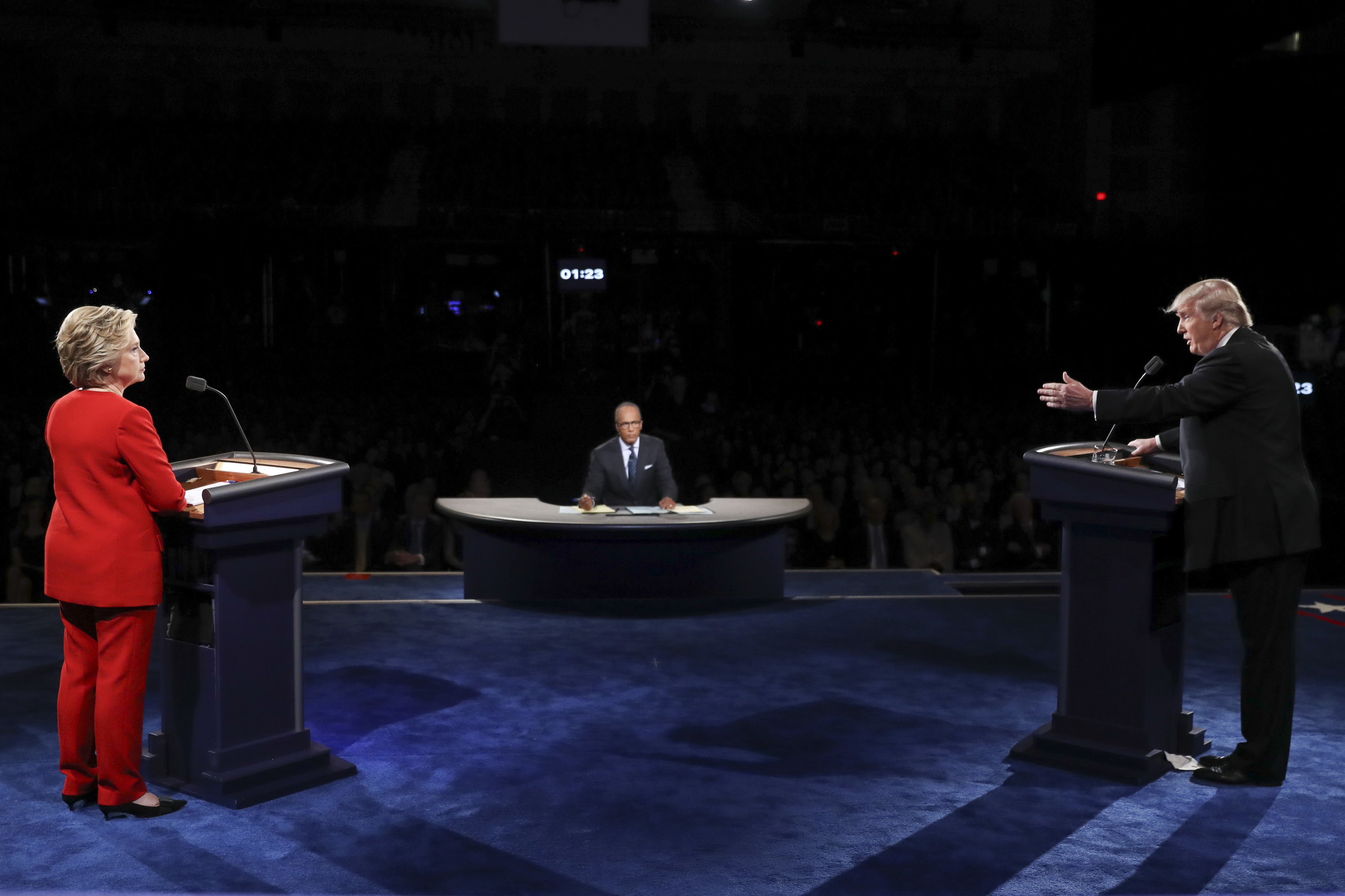 Republican presidential nominee Donald Trump points toward Democratic presidential nominee Hillary Clinton during the presidential debate at Hofstra University in Hempstead, N.Y., Monday, Sept. 26, 2016. (Joe Raedle/Pool via AP)