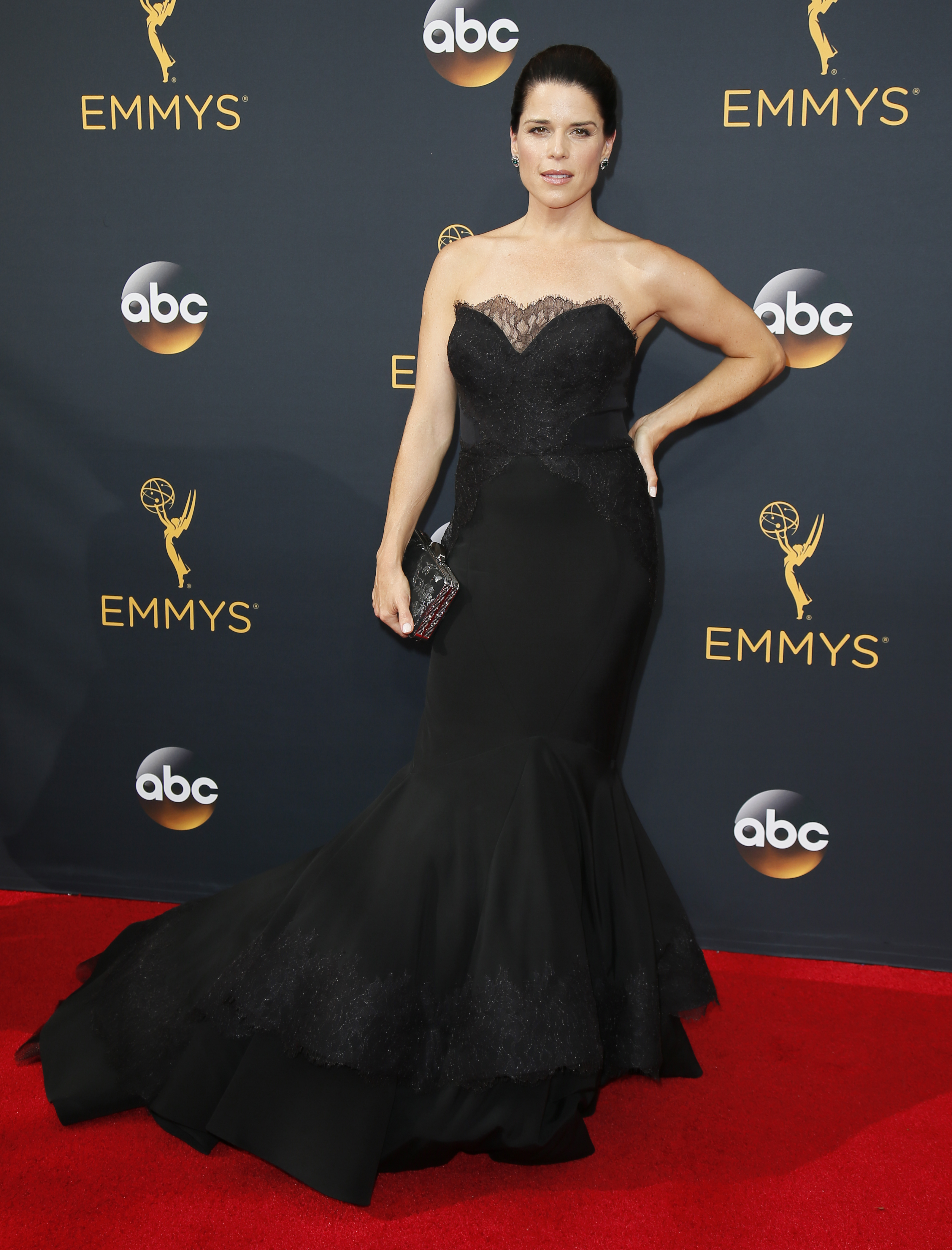 Neve Campbell arrives at the 68th Primetime Emmy Awards on Sunday, Sept. 18, 2016, at the Microsoft Theater in Los Angeles. (Photo by Danny Moloshok/Invision for the Television Academy/AP Images)