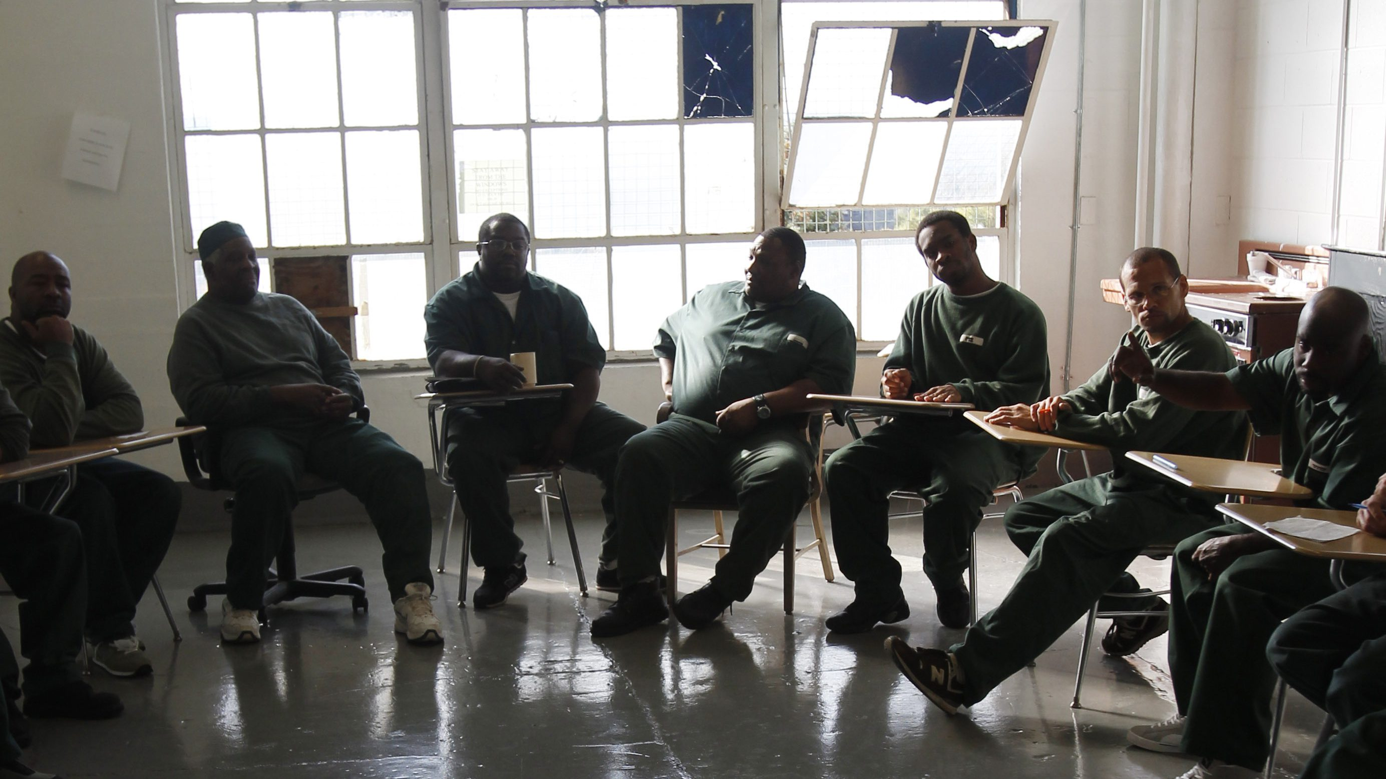 """FILE  - In this Oct. 6, 2011 file photo, inmates who are serving long-term or life sentences participate in a Lifer's and Long-Termer's Organization meeting at Clinton Correctional Facility, a maximum-security prison in Dannemora, N.Y.  The prison where two convicted killers pulled off a """"Shawshank Redemption""""-style escape this weekend has a reputation for brutality.  A 2014 report by the Correctional Association of New York, an independent non-profit that inspects state prisons and report on conditions, found that Clinton Correctional Facility is a place where there is little oversight, guards regularly beat inmates, and racial tension festers between its prisoners and correction officers. (AP Photo/Mike Groll, File)"""