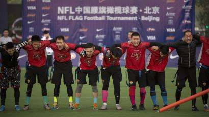 Chinese football players after a flag-football game
