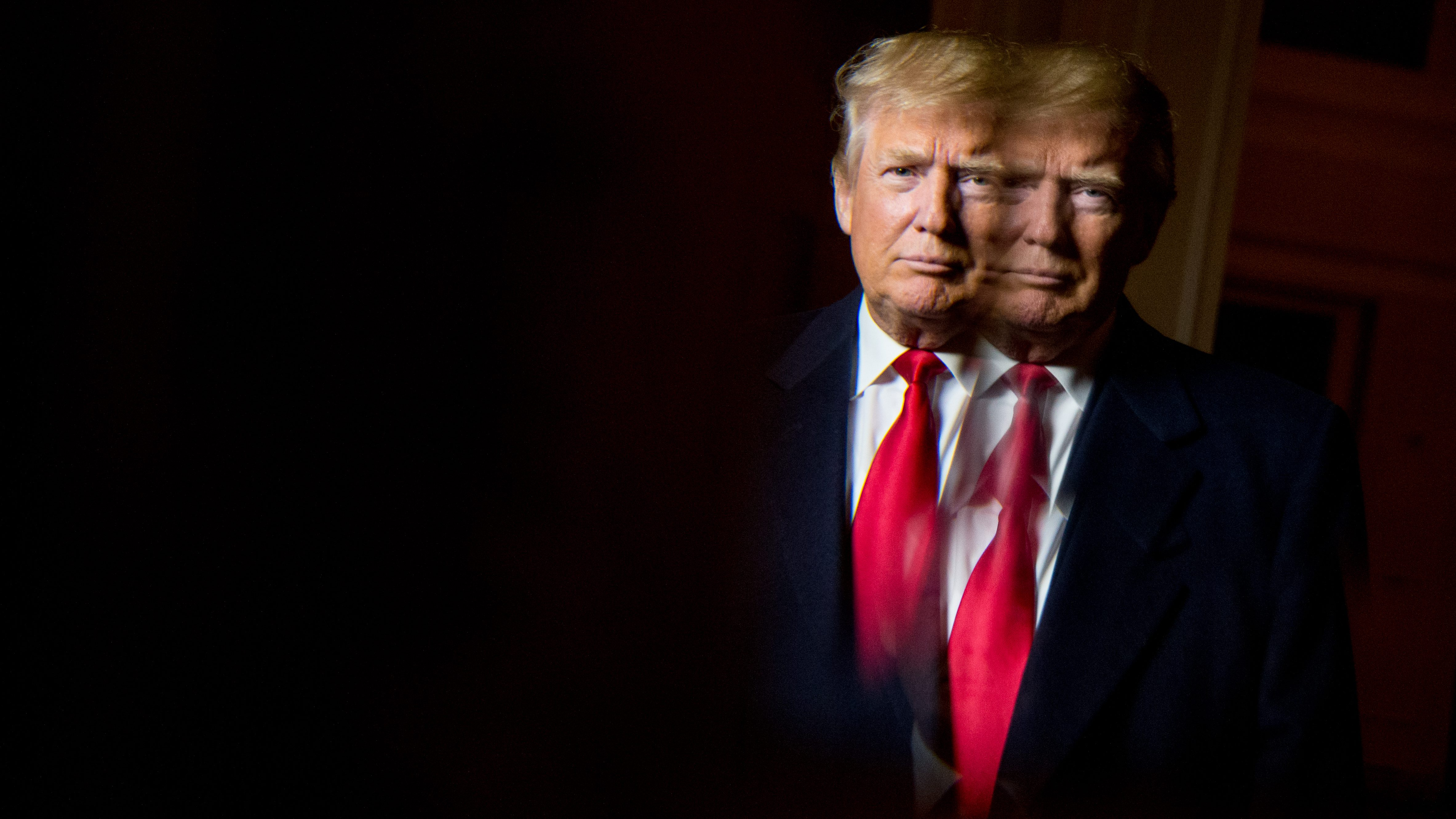 Republican presidential candidate Donald Trump, seen in reflection, poses for a portrait following an interview with the Associated Press at the Trump National Golf Club in Sterling, Va., Wednesday, Dec. 2, 2015.