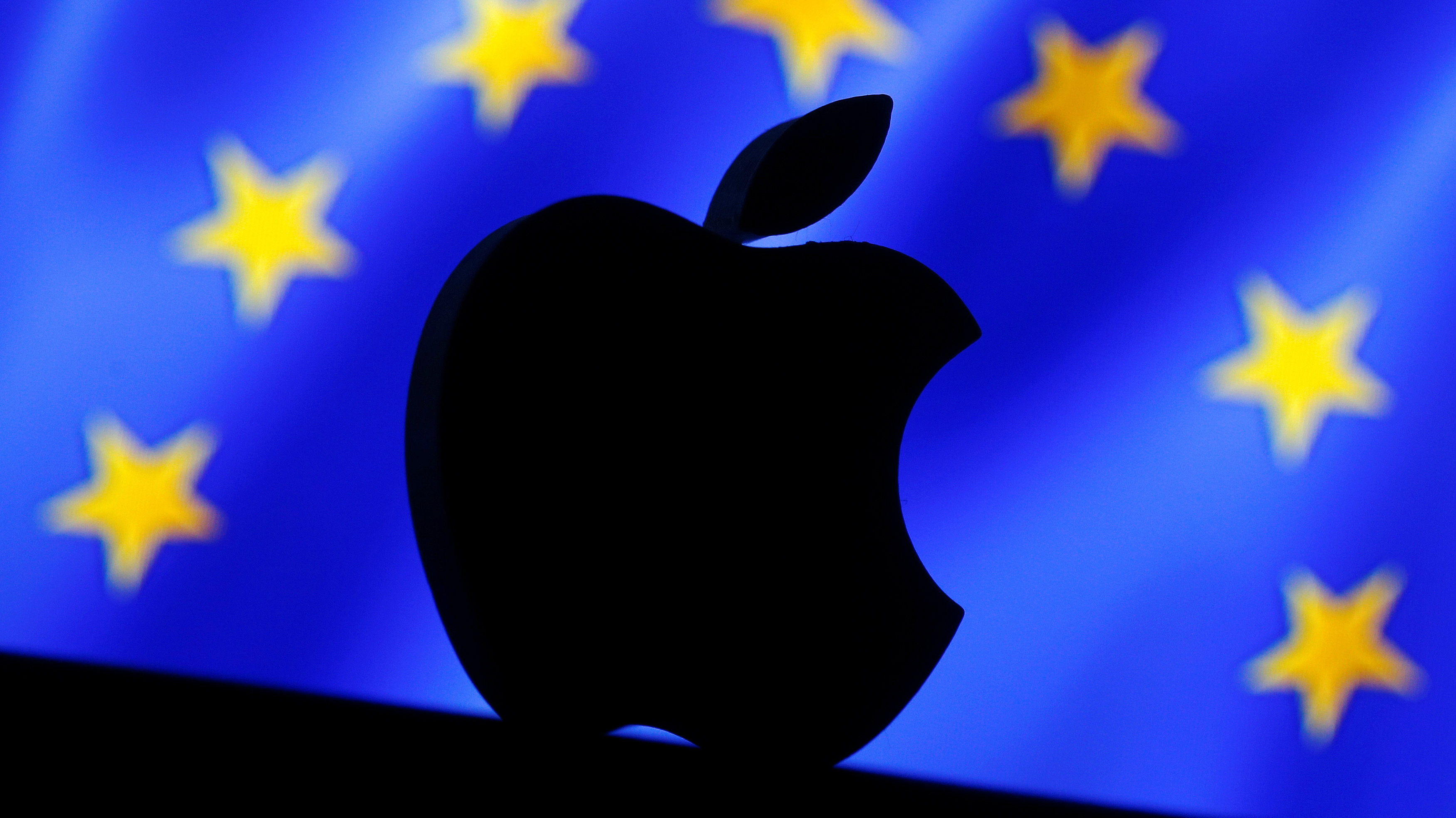 A 3D printed Apple logo is seen in front of a displayed European Union flag in this illustration taken September 2, 2016. REUTERS/Dado Ruvic/Illustration TPX IMAGES OF THE DAY
