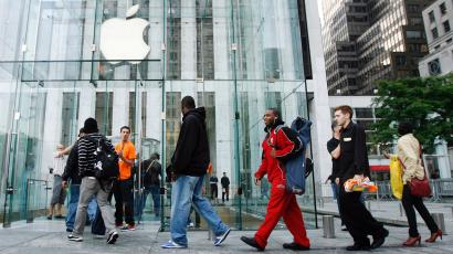 Customers line up outside Apple Store