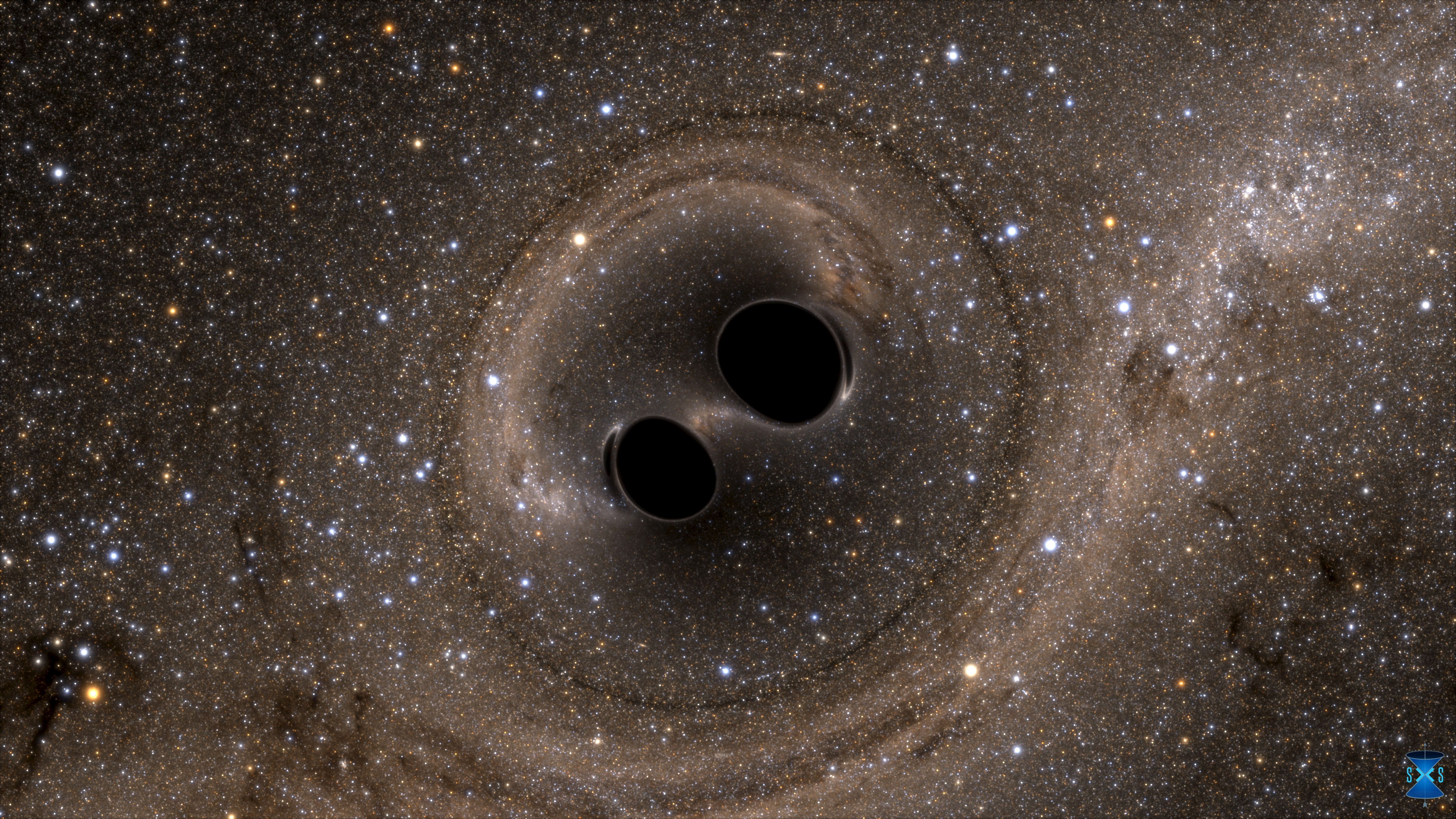 The collision of two black holes  - a tremendously powerful event detected for the first time ever by the Laser Interferometer Gravitational-Wave Observatory, or LIGO - is seen in this still image from a computer simulation released in Washington February 11, 2016. Scientists have for the first time detected gravitational waves, ripples in space and time hypothesized by Albert Einstein a century ago, in a landmark discovery announced on Thursday that opens a new window for studying the cosmos.