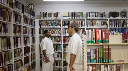 prisoners among books in a library