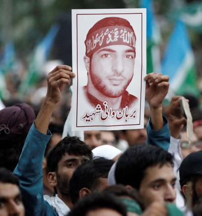 A picture of Hizbul Mujahideen commander Burhan Muzaffar Wani is held up during a rally condemning the violence in Kashmir, in Islamabad