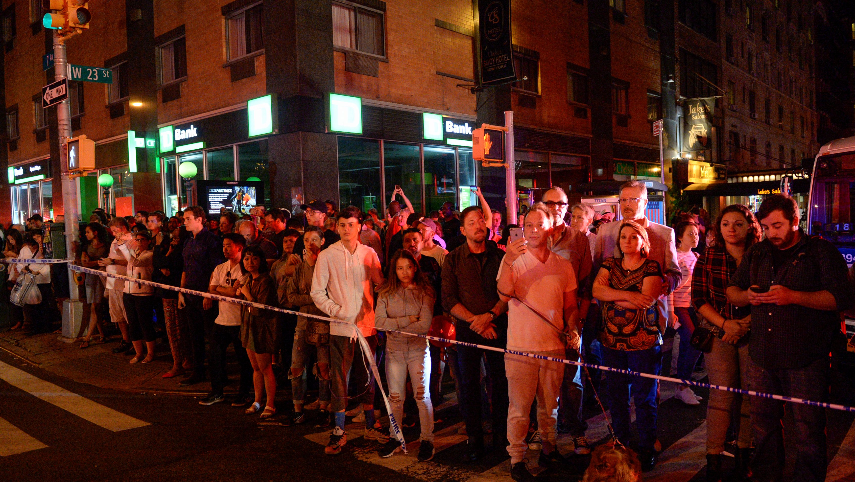 Onlookers stand behind a police cordon near the site of an explosion in the Chelsea neighborhood of Manhattan, New York, U.S.  September 17, 2016.  REUTERS/Rashid Umar Abbasi - RTSO7VJ