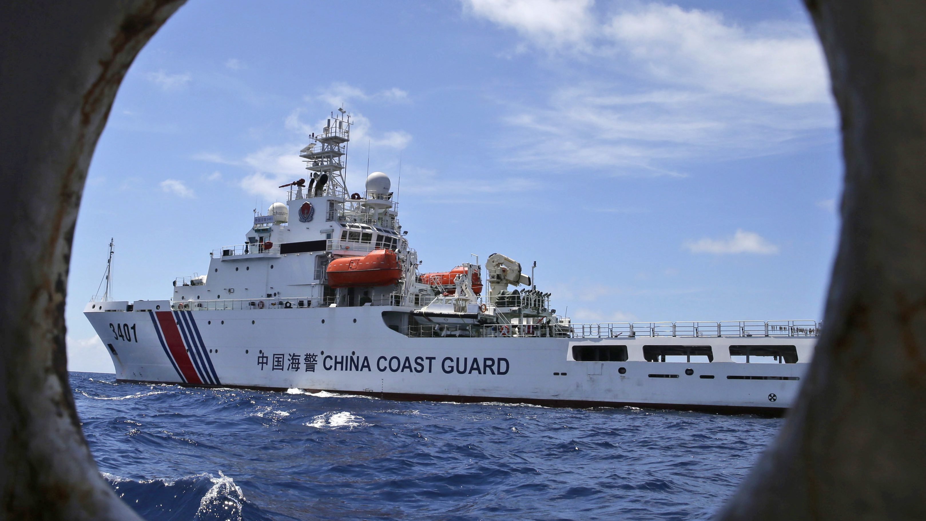 In this March 29, 2014 file photo, a Chinese Coast Guard ship attempts to block a Philippine government vessel as the latter tries to enter Second Thomas Shoal in the South China Sea to relieve Philippine troops and resupply provisions. While the global economy will dominate at the summit of the Group of 20 industrialized and emerging-market nations, politics and security issues form the backdrop to the gathering of world leaders in the eastern Chinese city of Hangzhou.